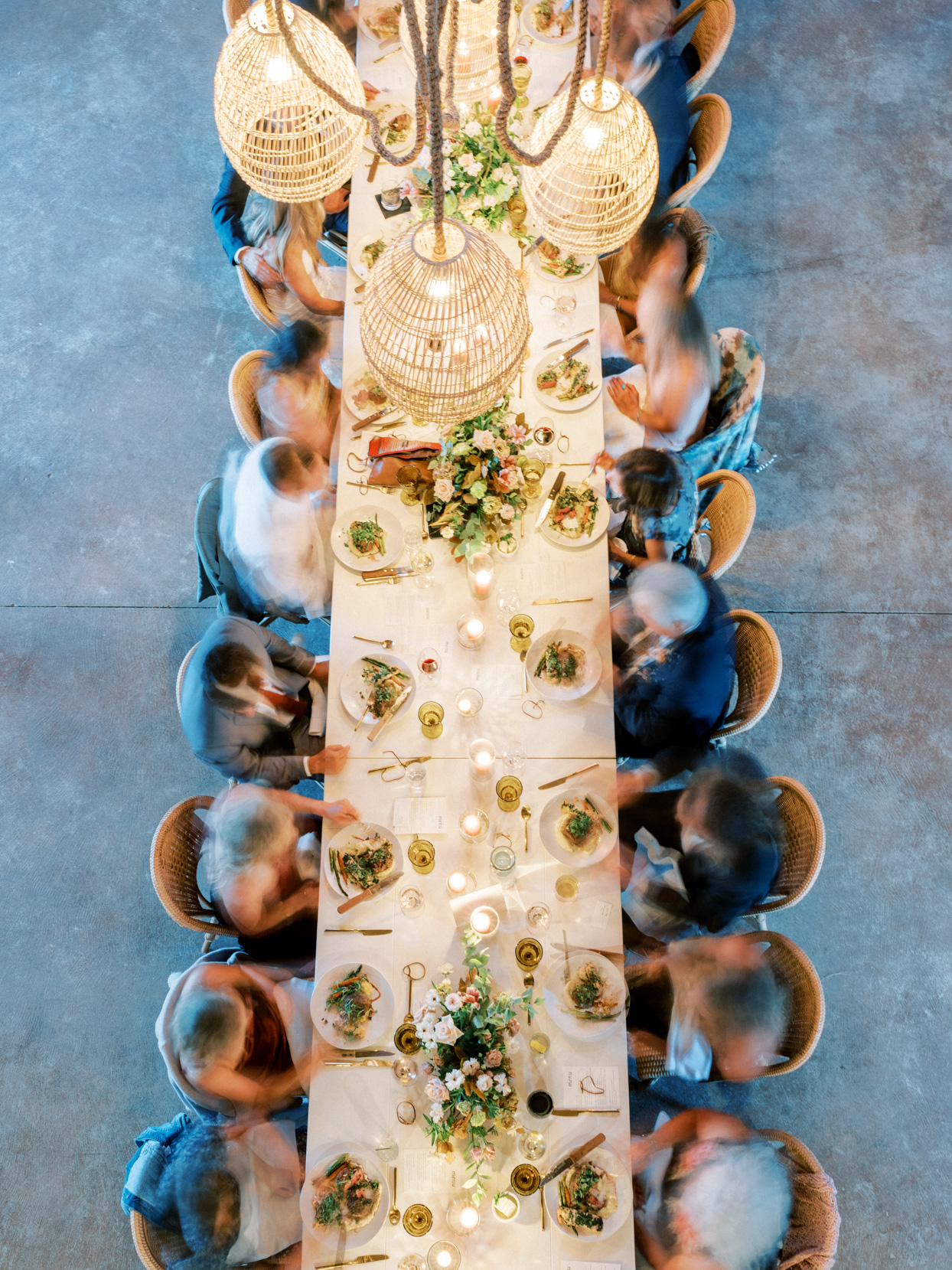 long dinner table with seated guests