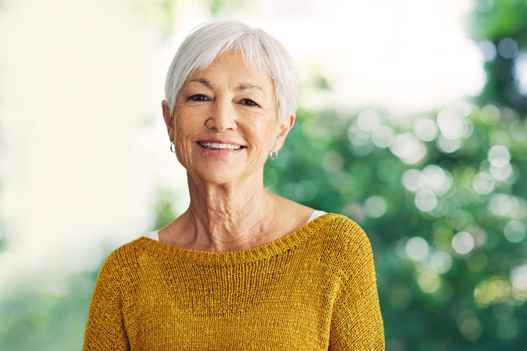 smiling woman with thinning eyebrows