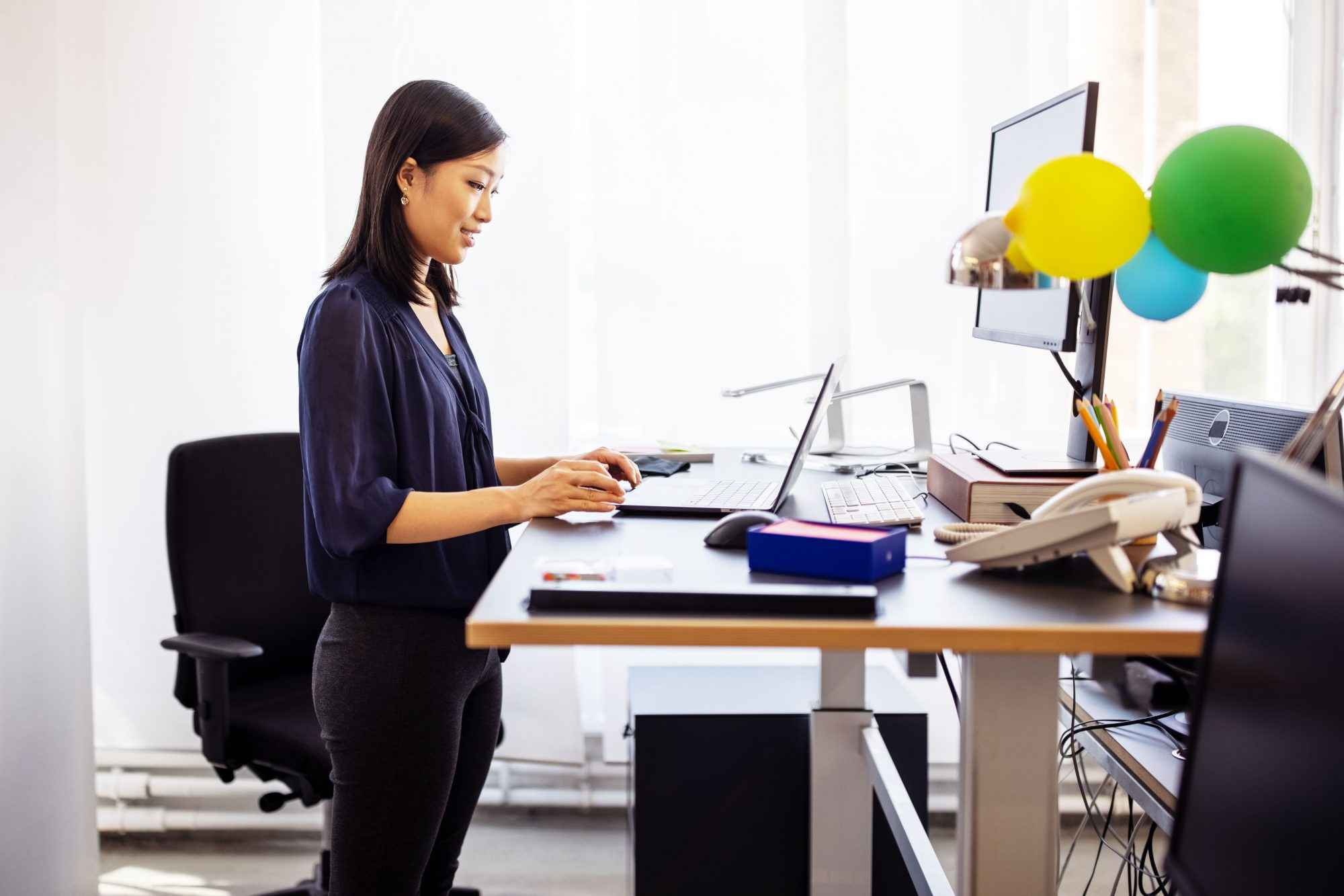 woman working using standing desk