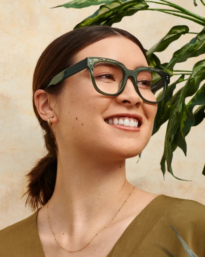woman wearing eye buy direct glasses