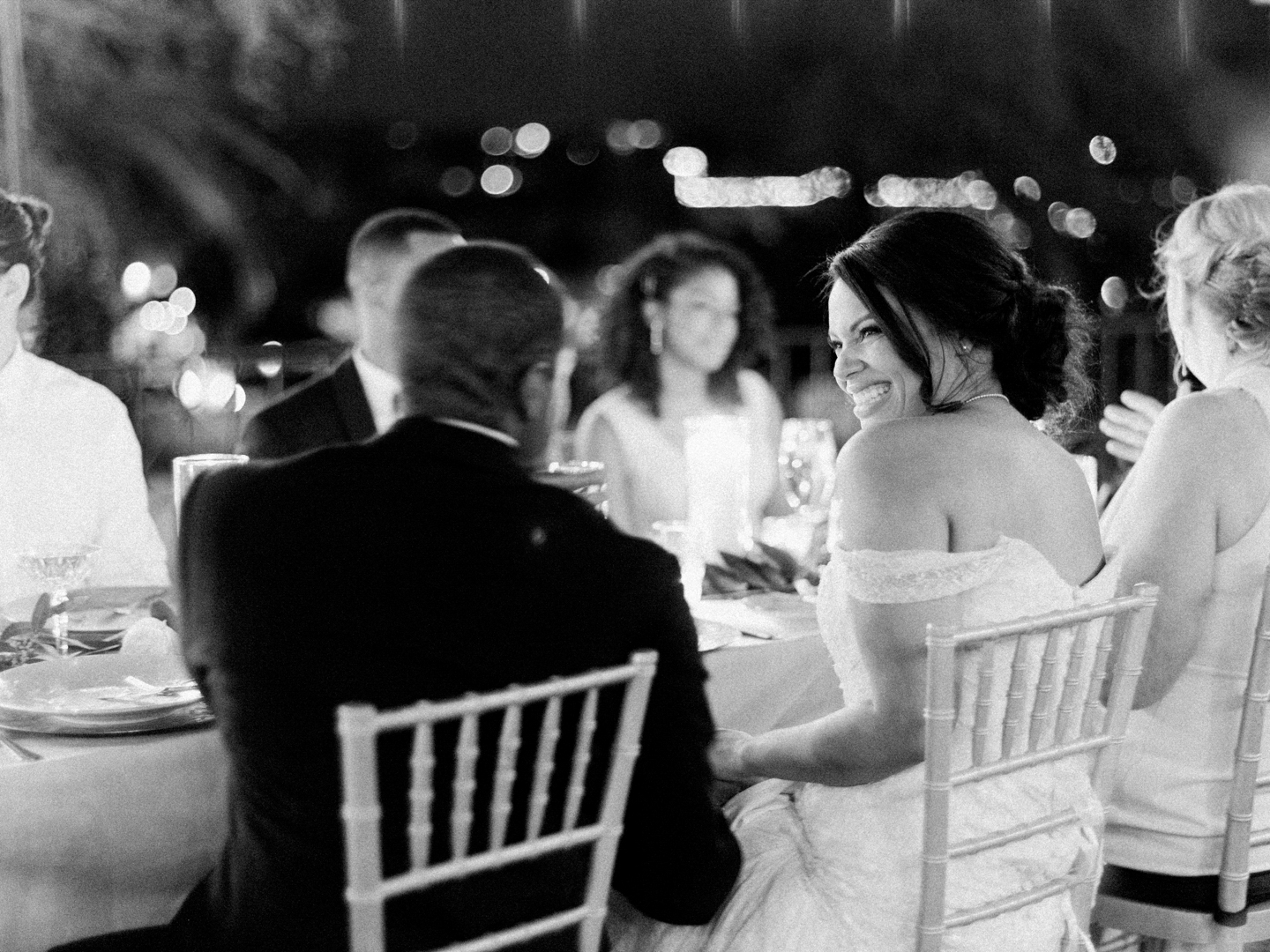 bride and groom seated at reception table