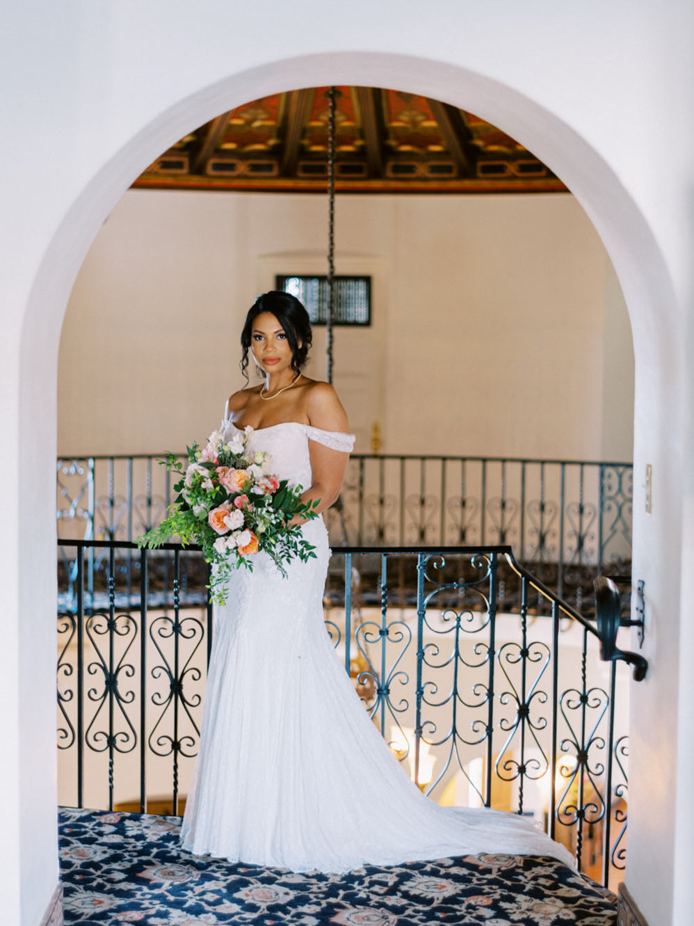 bride posting with bouquet