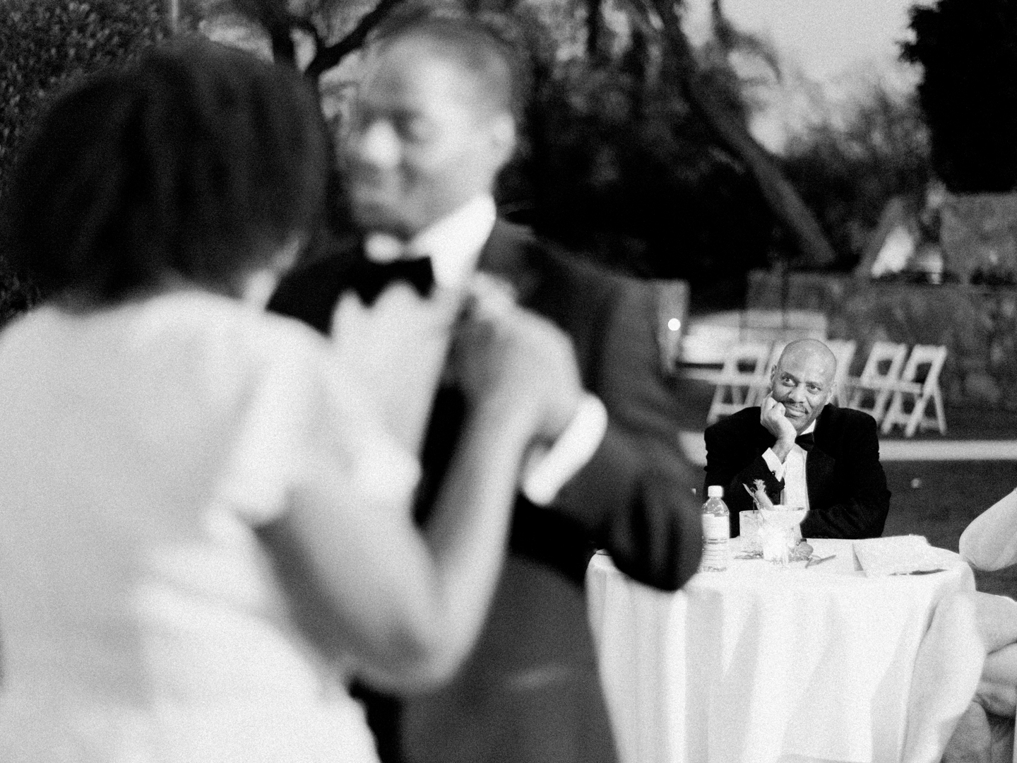 father of the groom watching the dance floor