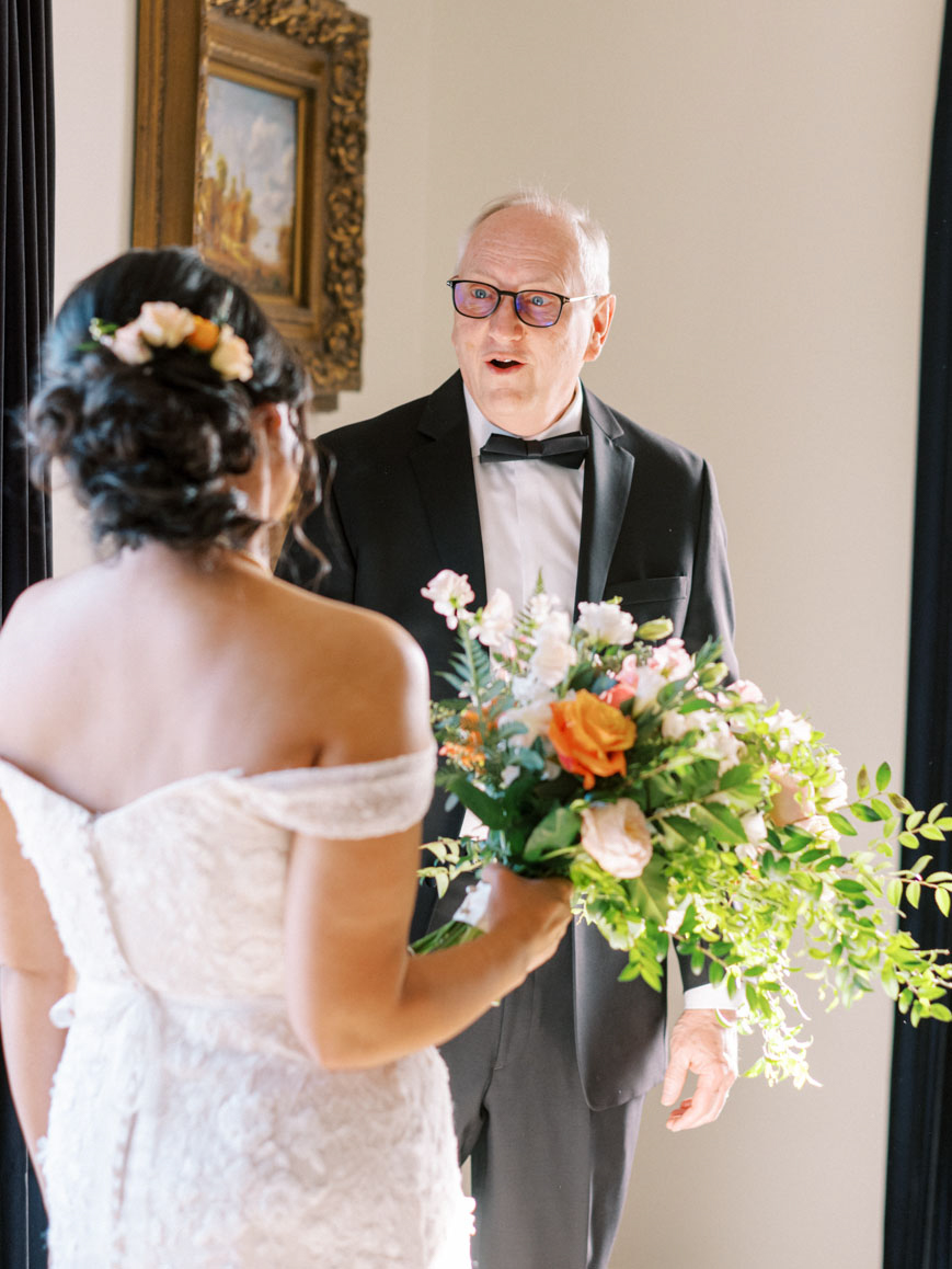bride first look with dad
