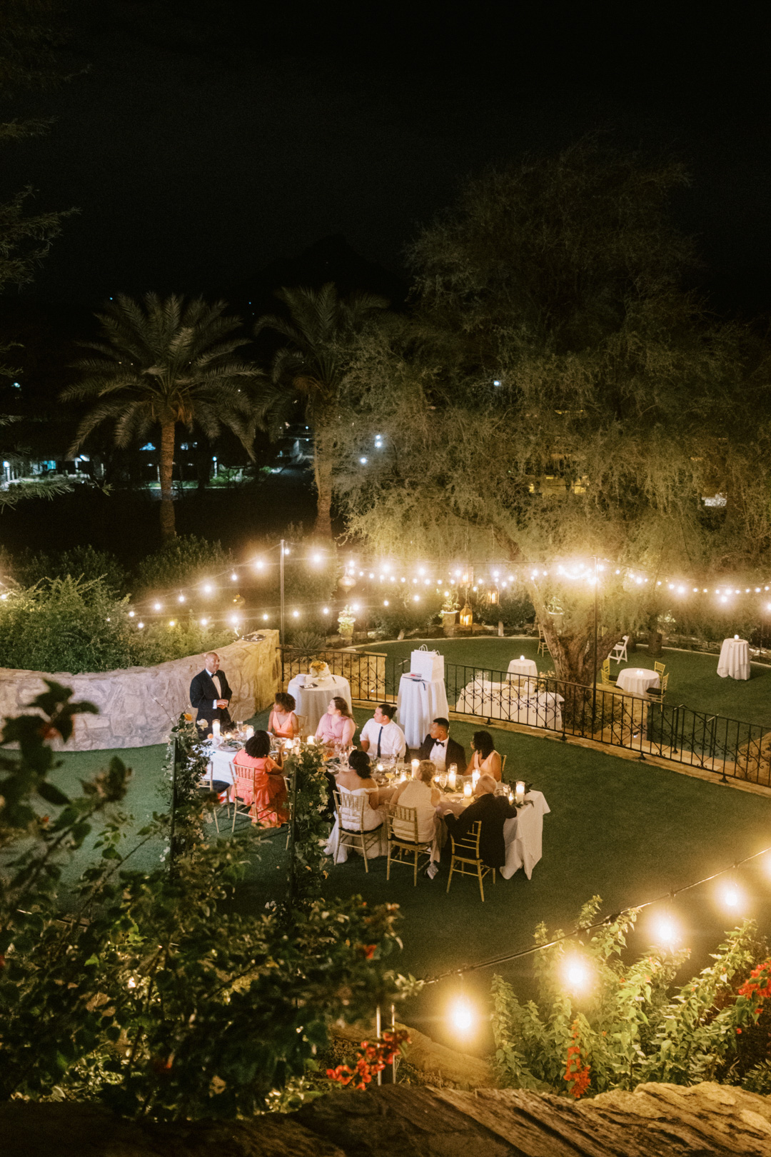 outdoor reception table set with greenery and candles