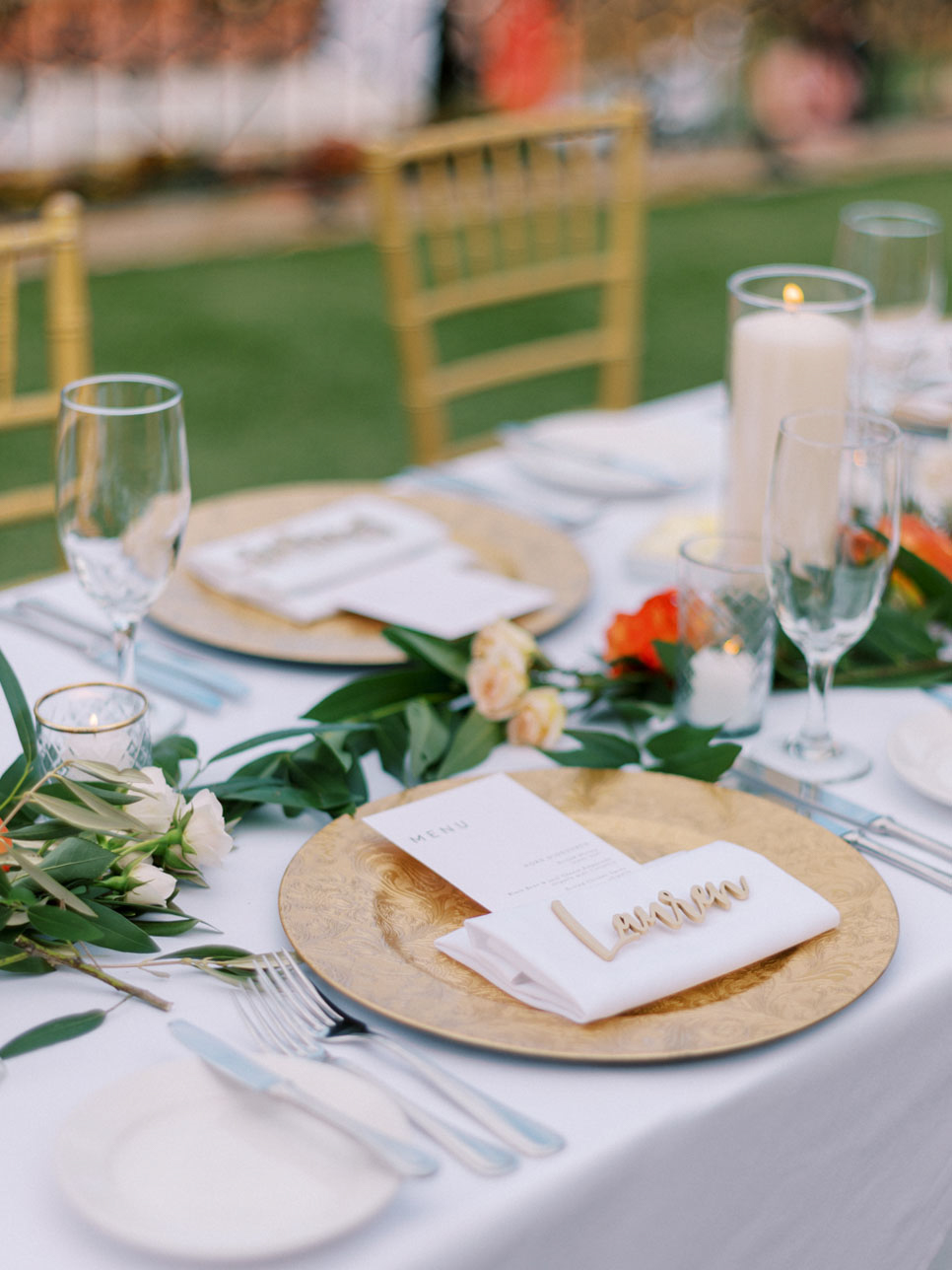 dinner menu with gold charger and greenery
