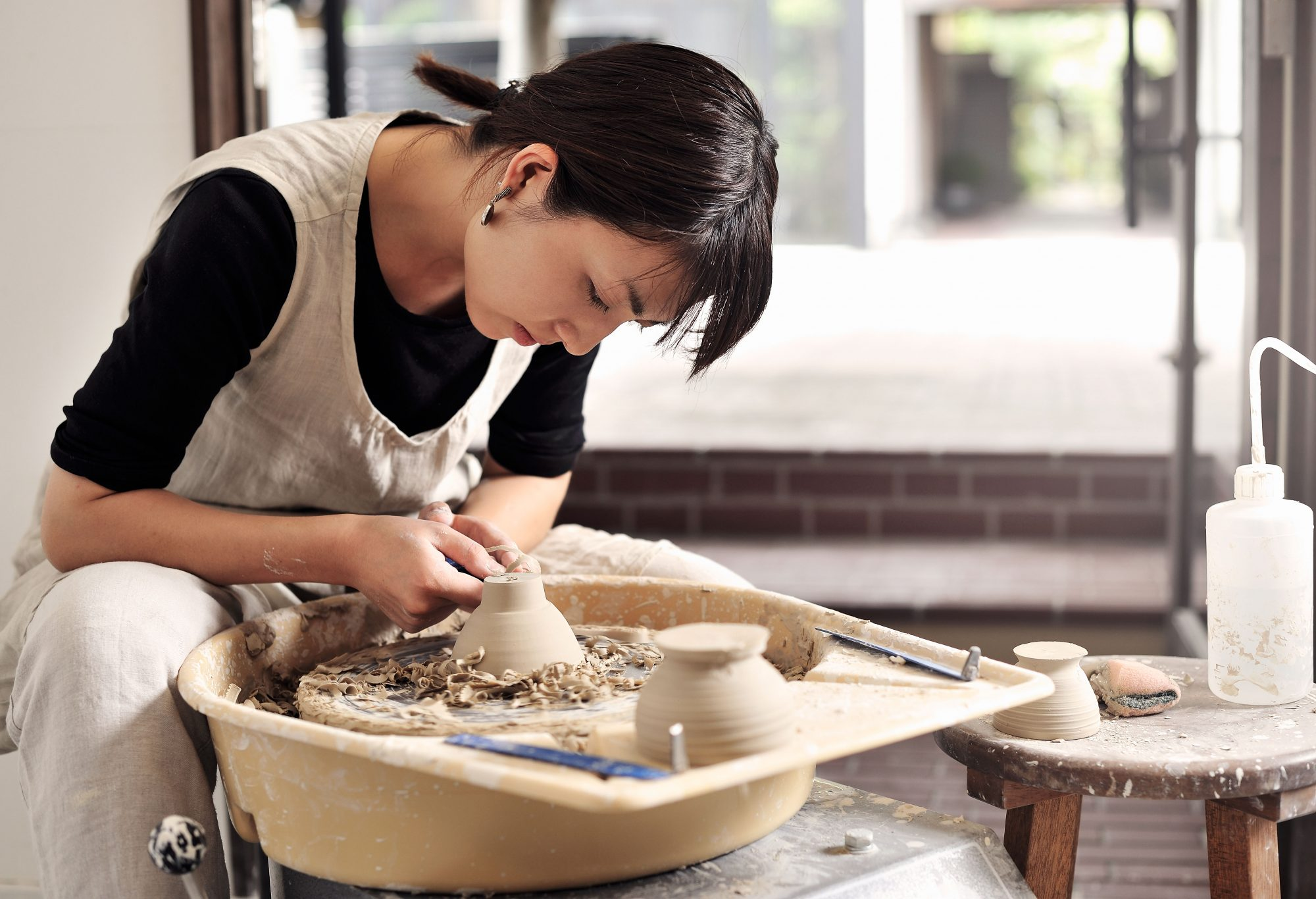 Potter are making a bowl in the studio