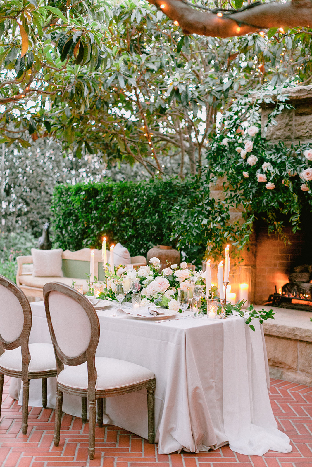 elegant sweetheart table in front of fireplace for wedding reception