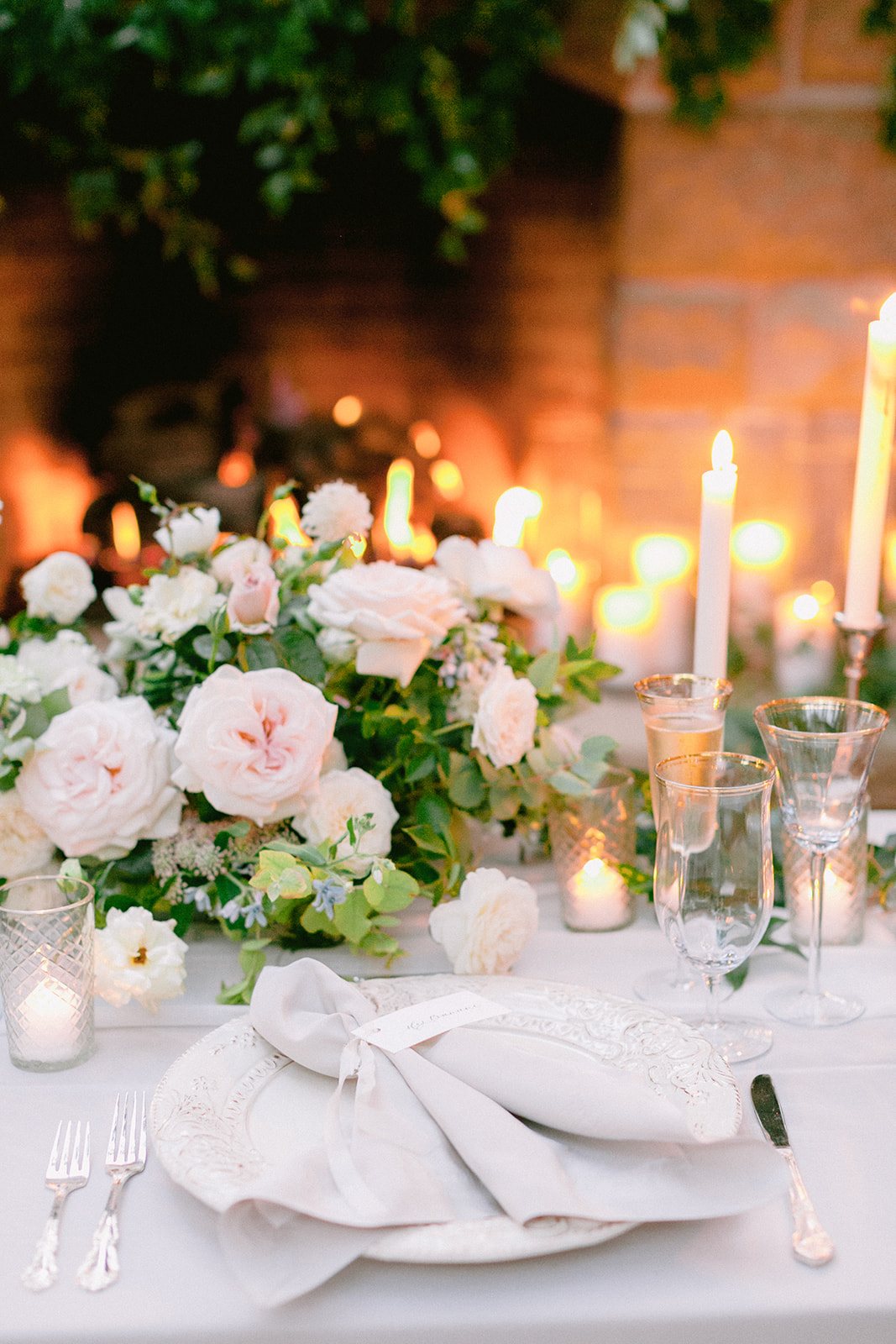 elegant white and pastel pink wedding place setting