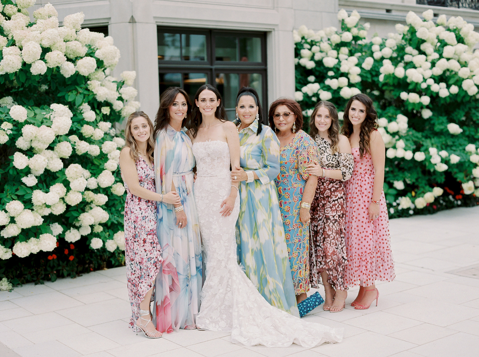 bride posing with bridal party family