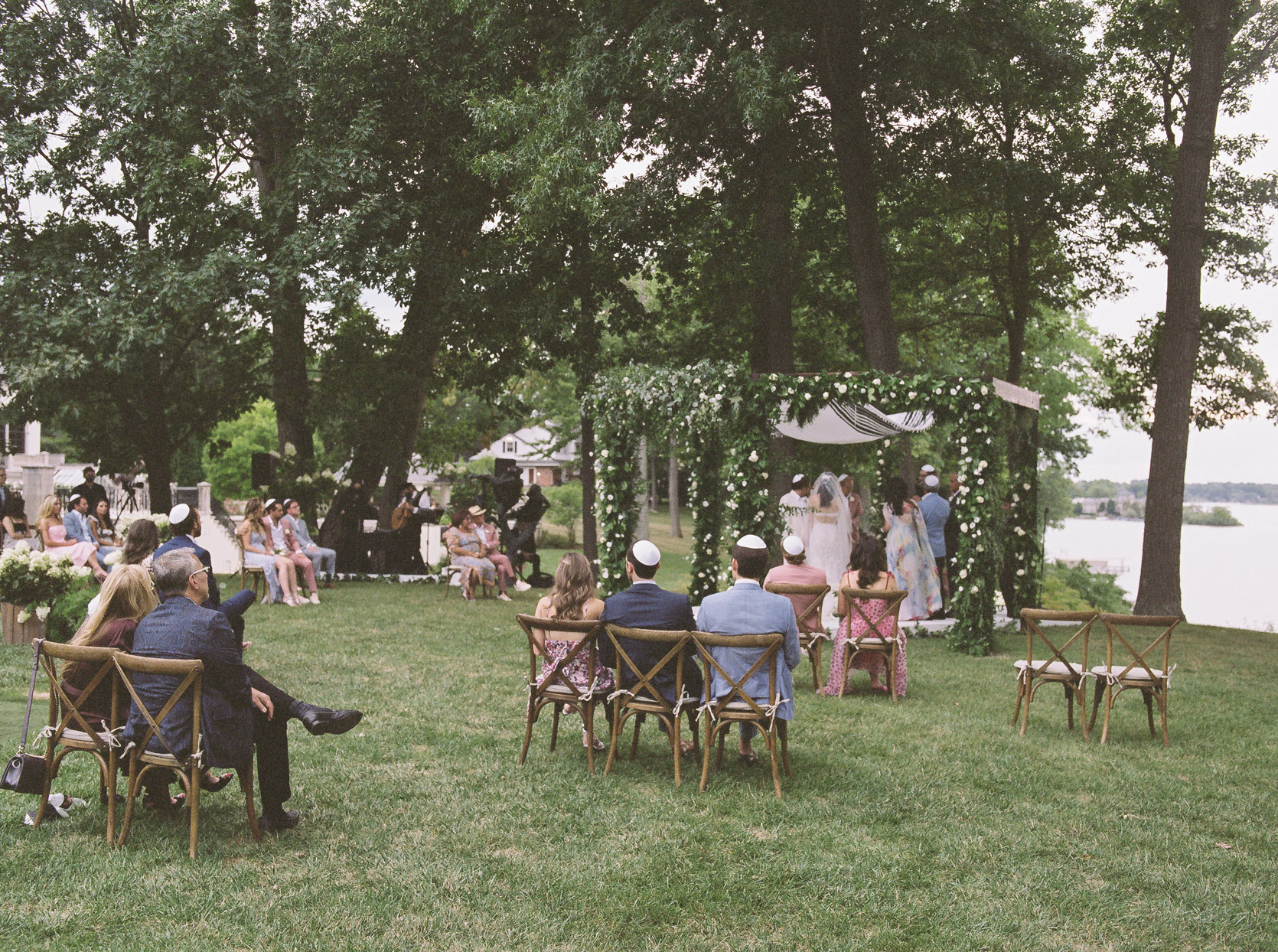 socially distant outdoor wedding ceremony at orchard lake