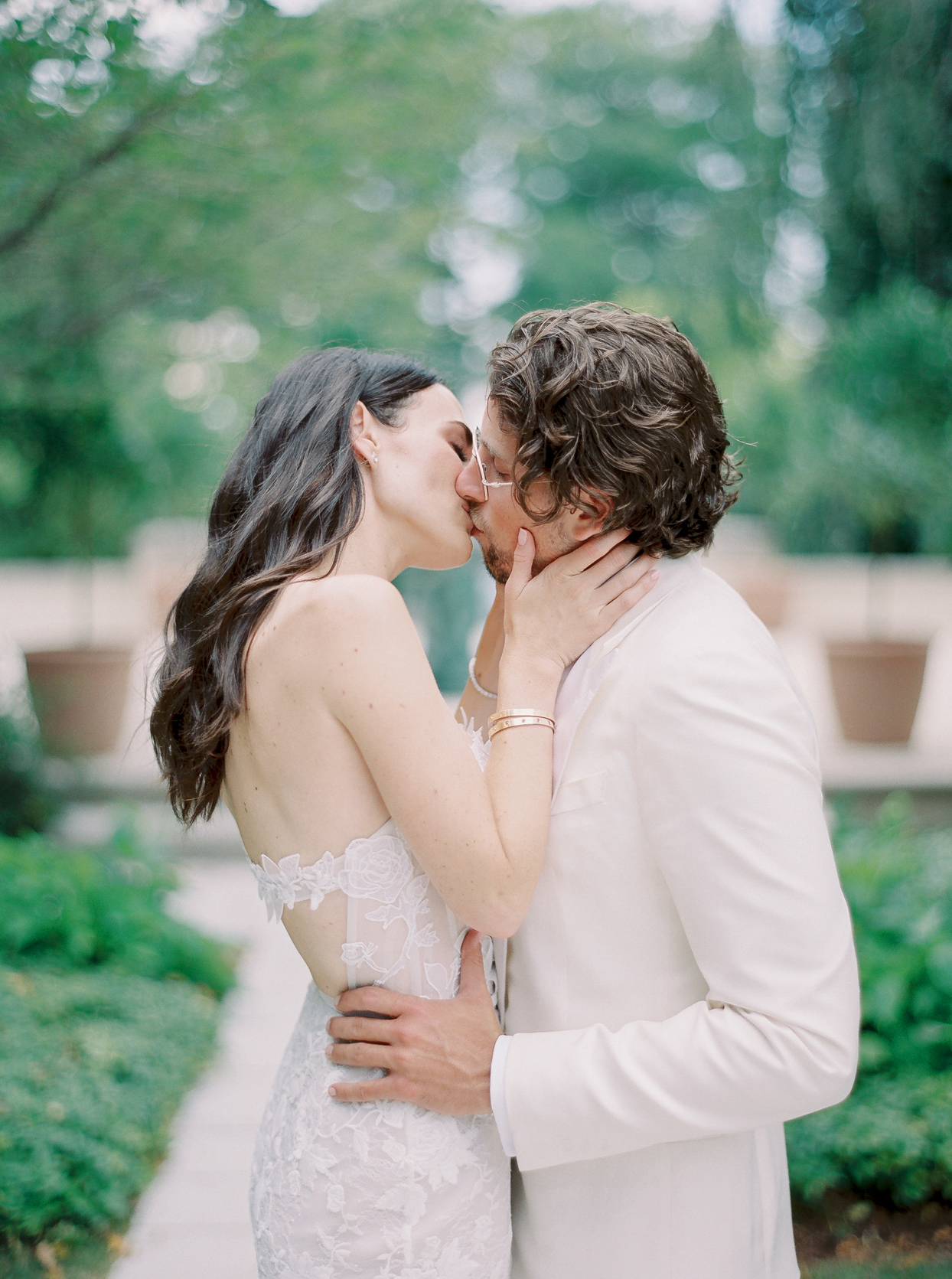 bride and groom embracing and kissing