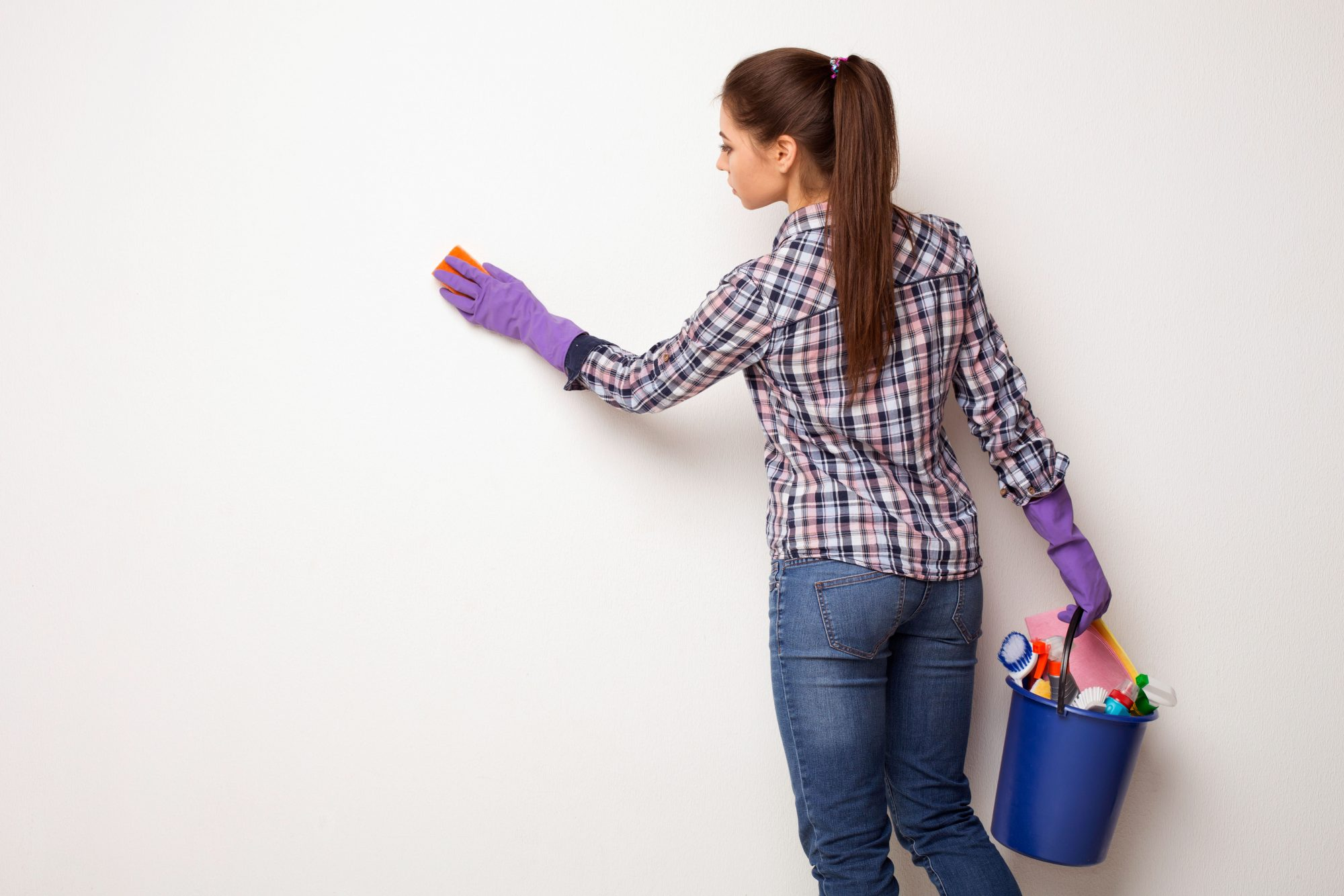 cleaning interior wall with sponge