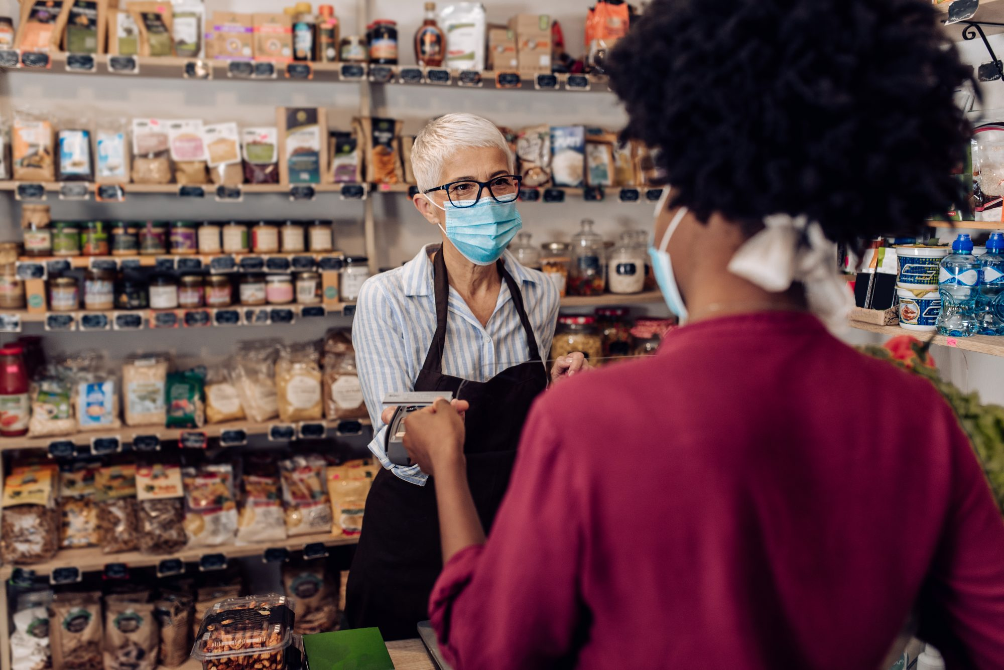 Buying items from small business wearing masks