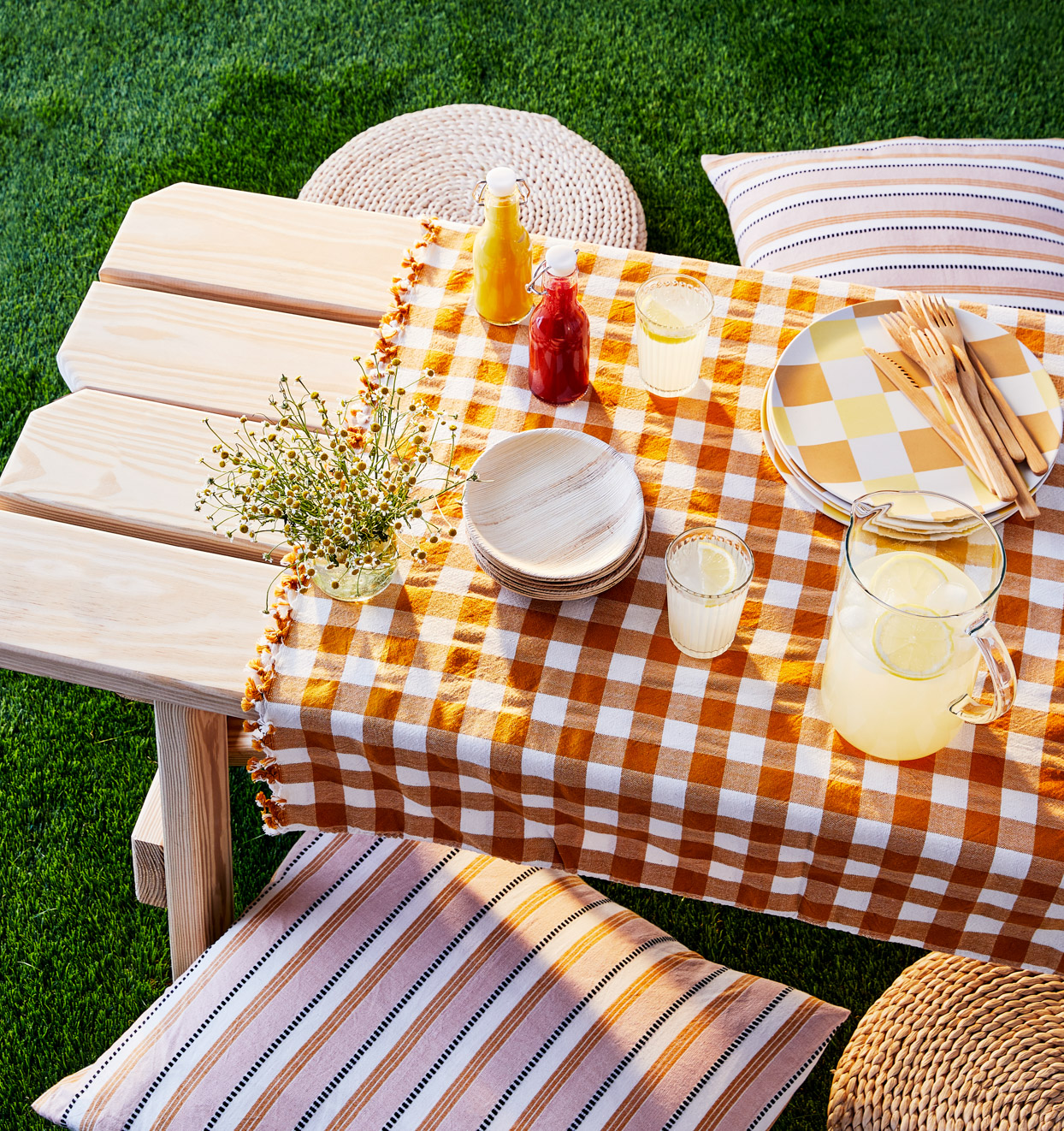 wooden picnic table with checkered cloth