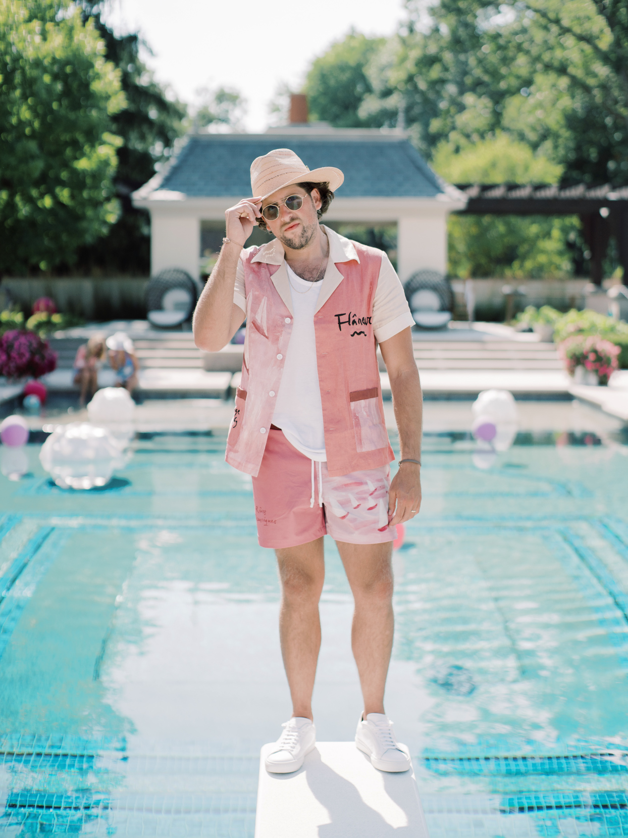 groom in pink swim trunks and matching button up