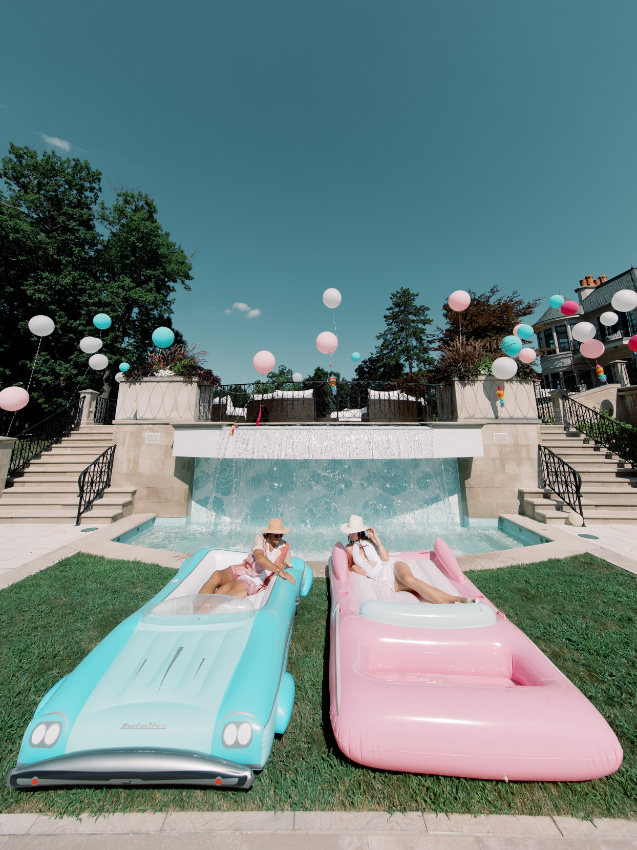 bride and groom on blue and pink pool floats
