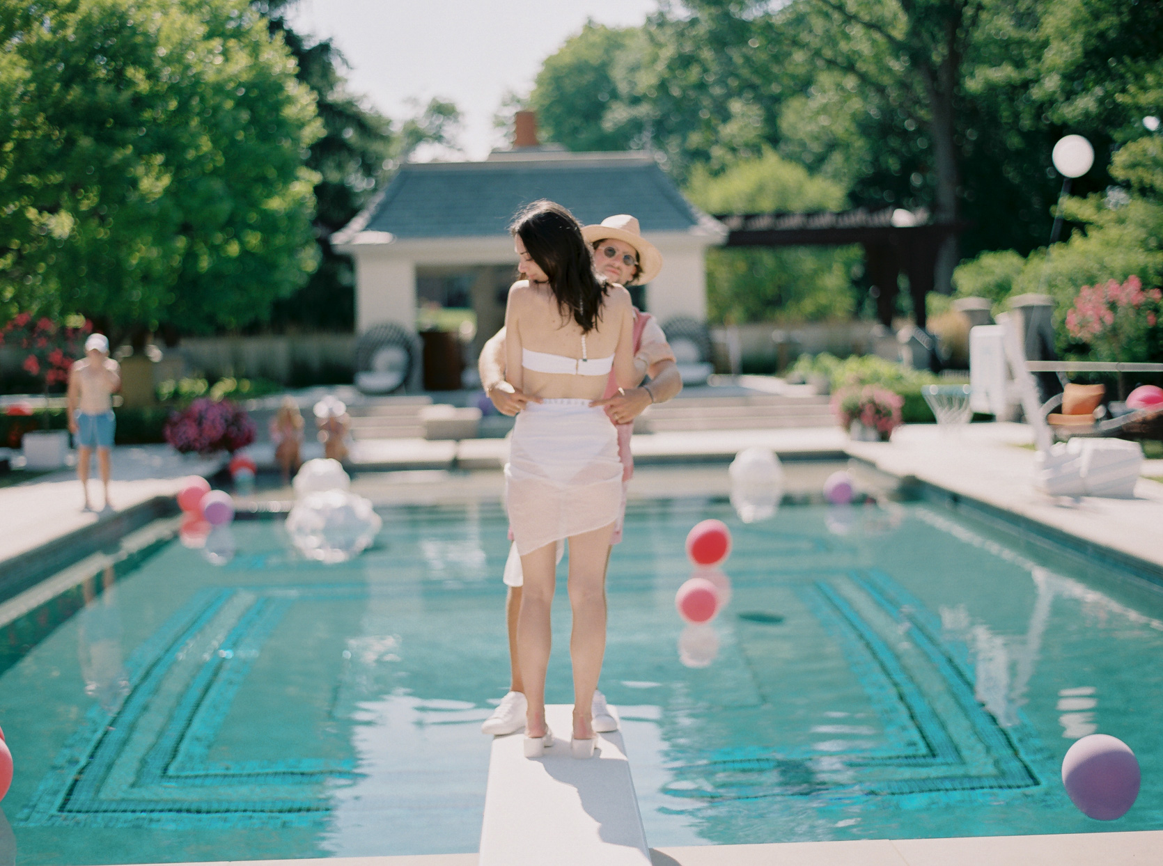 bride and groom on diving board