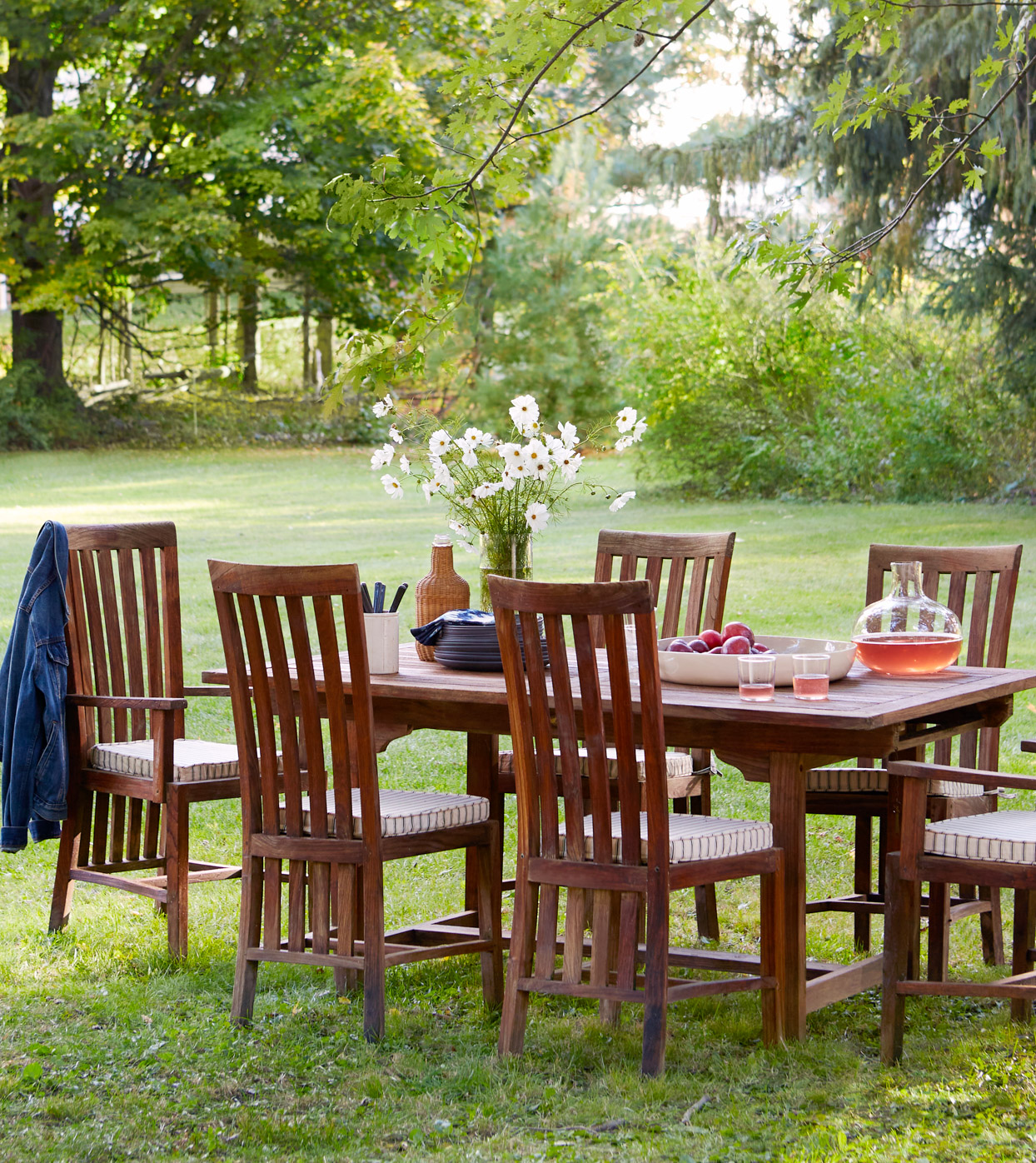 wooden dinning table and chairs in grass
