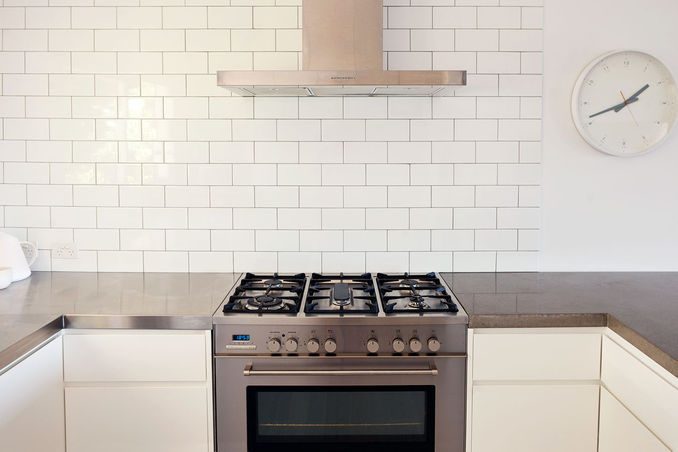 clean modern kitchen with stainless steel stove