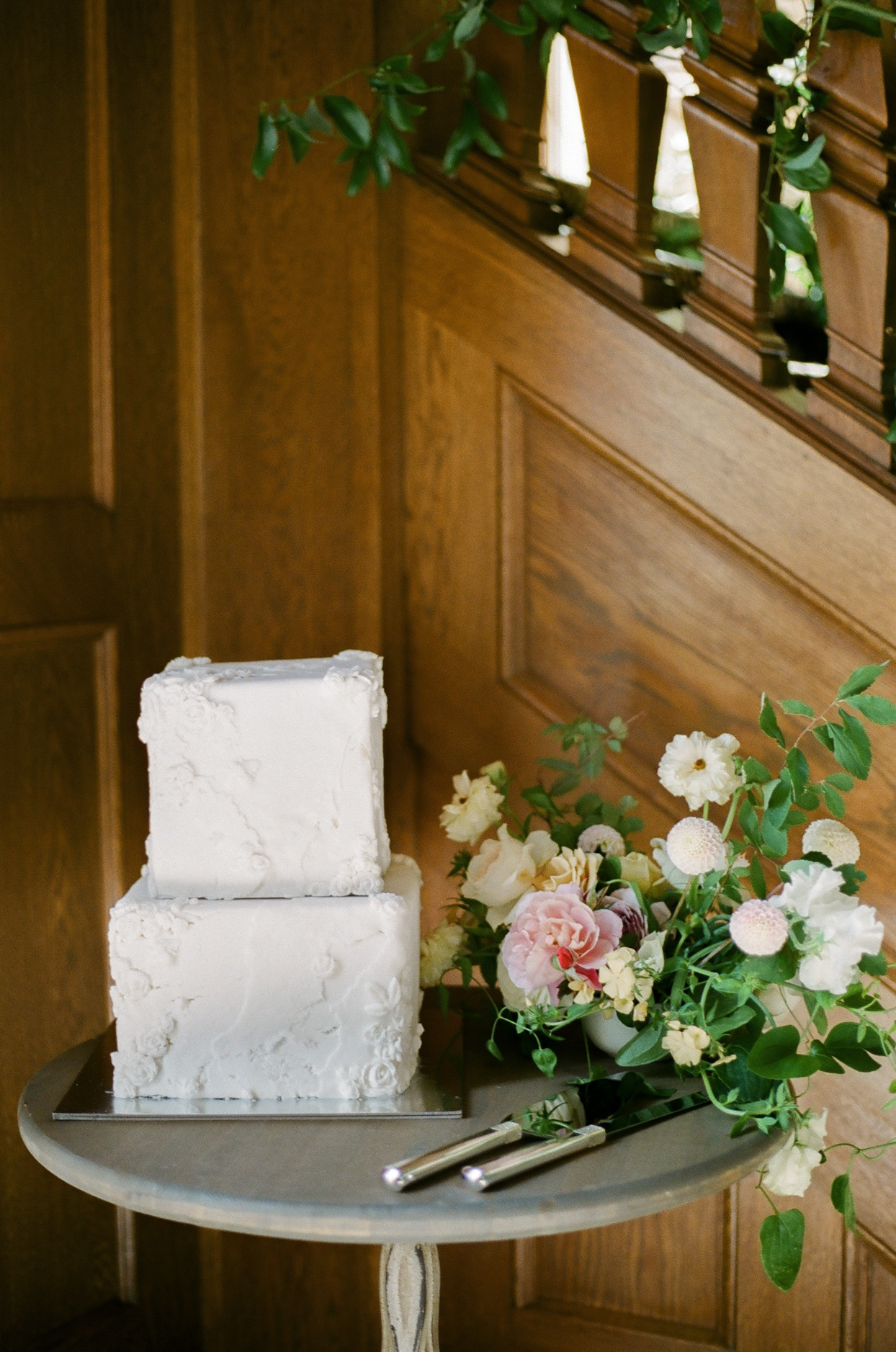 two tiered square layers white frosted wedding cake