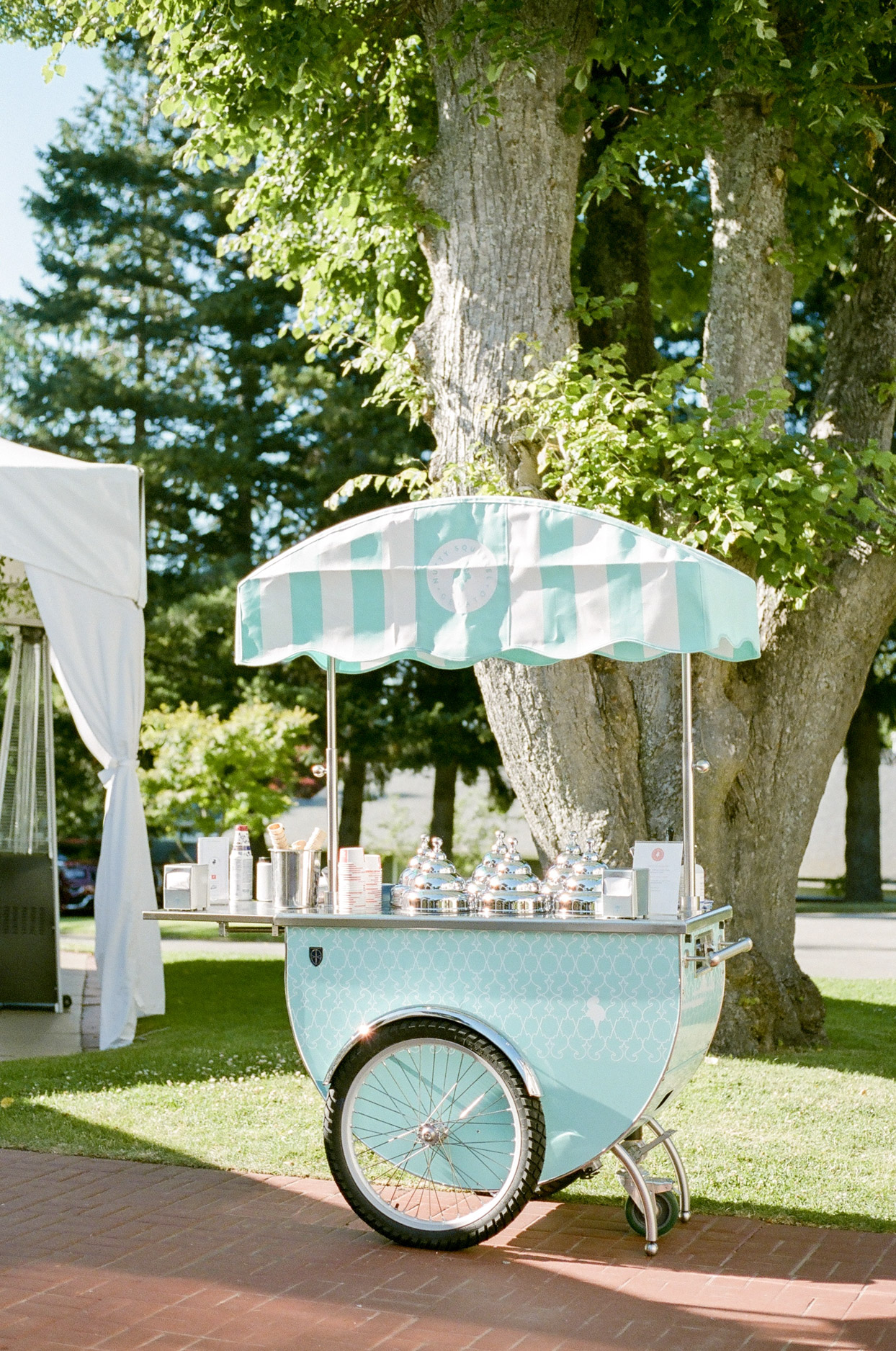 teal and white ice cream cart