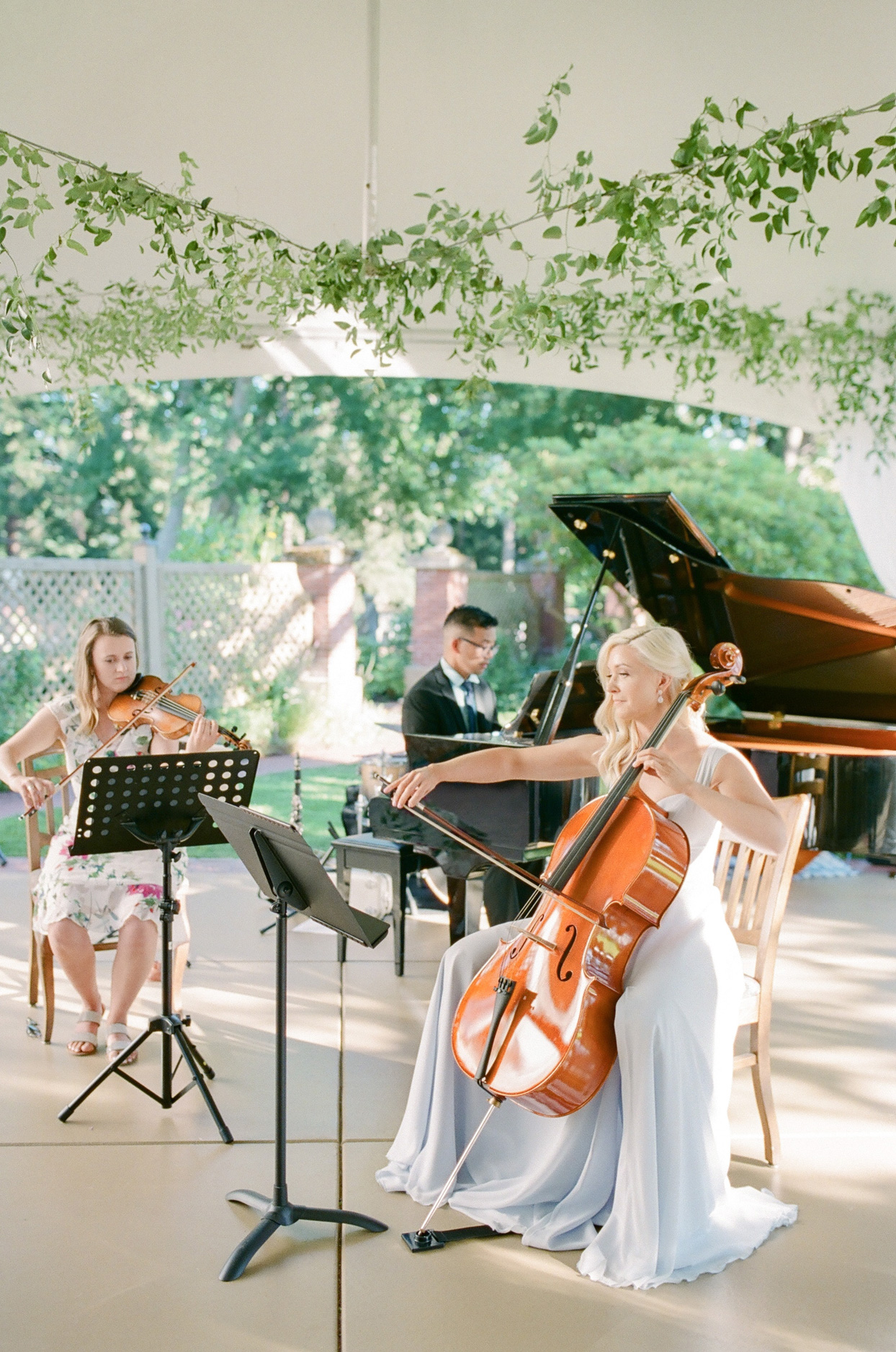 violinist, cellist, and pianist playing music
