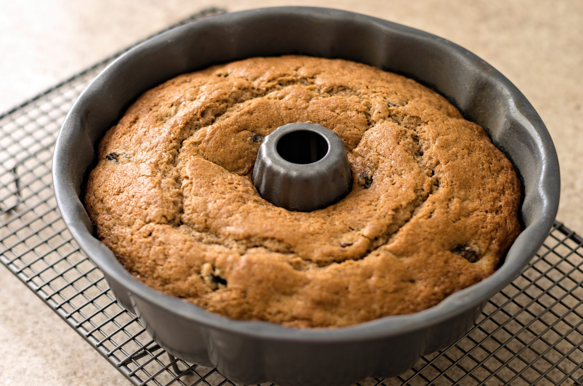 bundt cake in pan on cooling rack