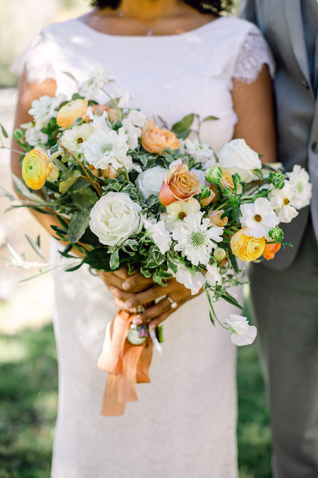 white, yellow, and orange floral wedding bouquet