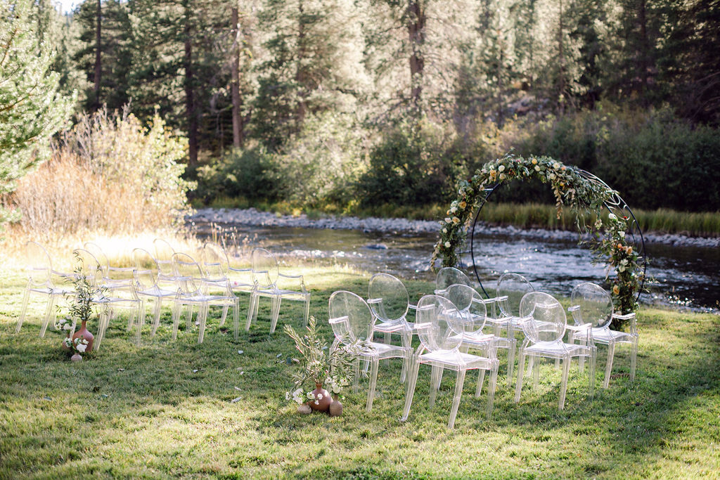 clear chairs seating area outdoor wedding ceremony space