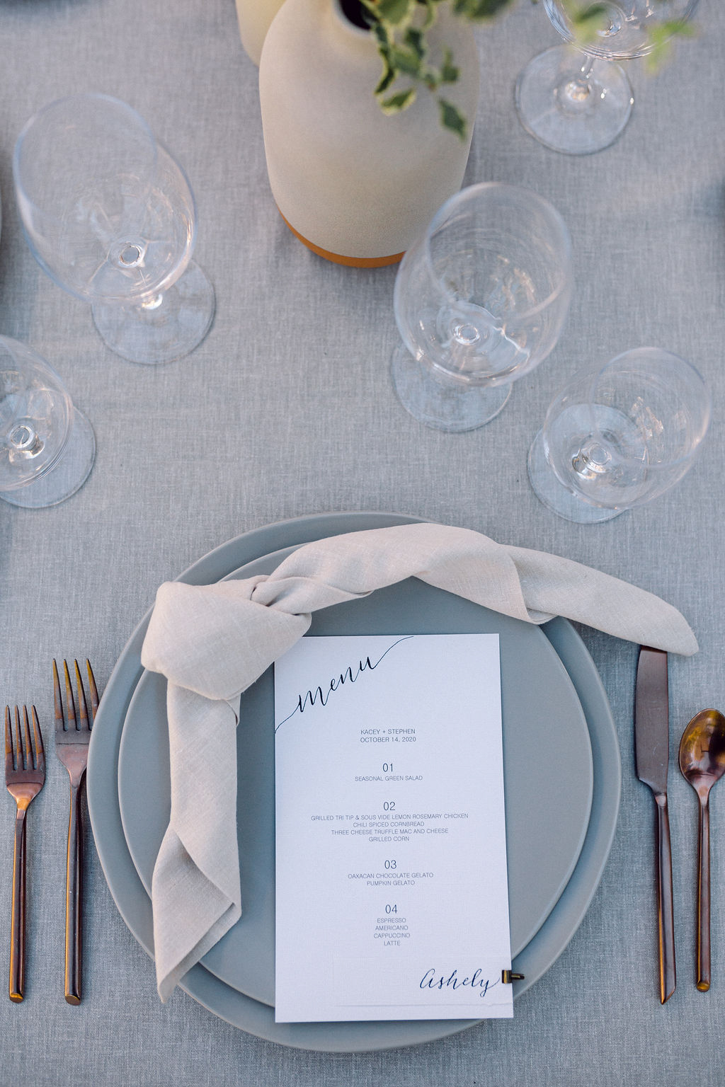 muted tones wedding reception place settings with menu