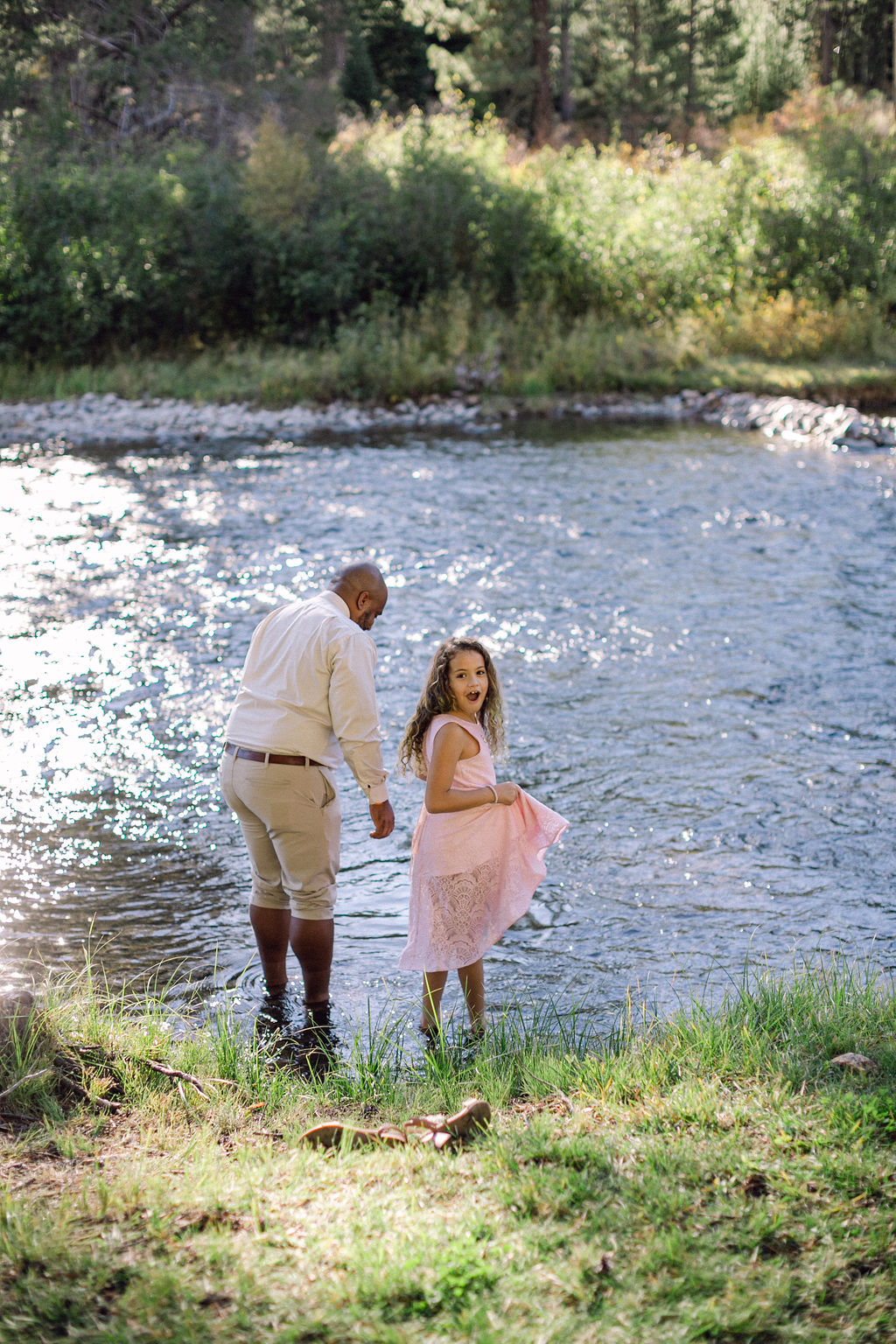 wedding guests standing in river