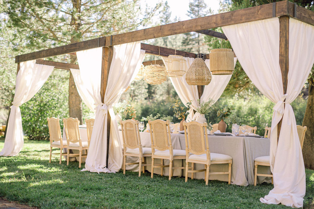 wedding table outside with cream colored linens