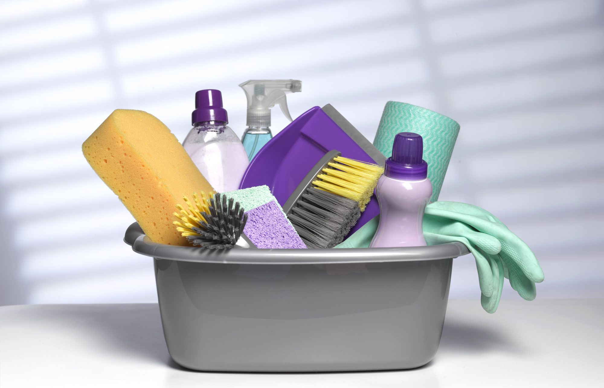 cleaning products in plastic tub