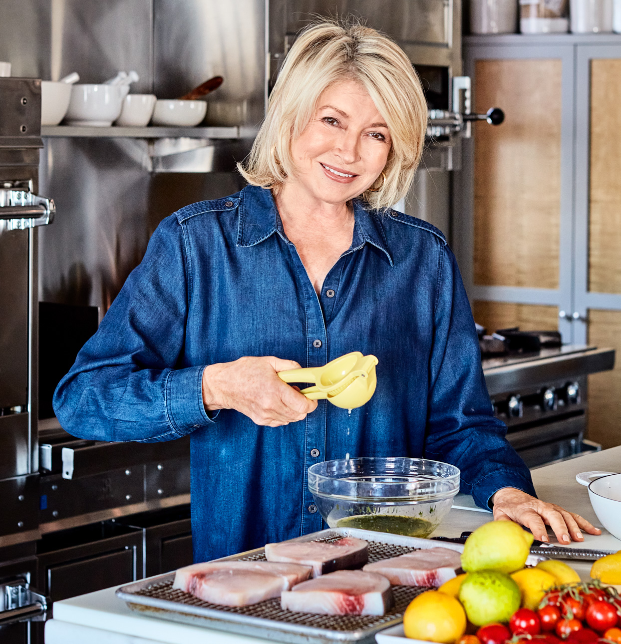Martha Stewart juicing in kitchen