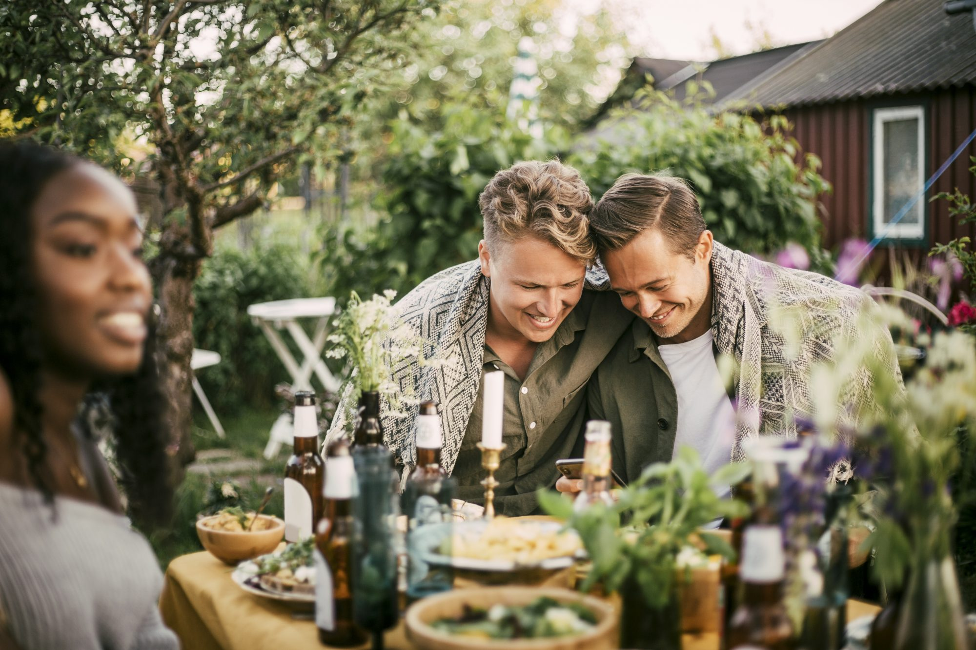 couple at outdoor dinner party with friends