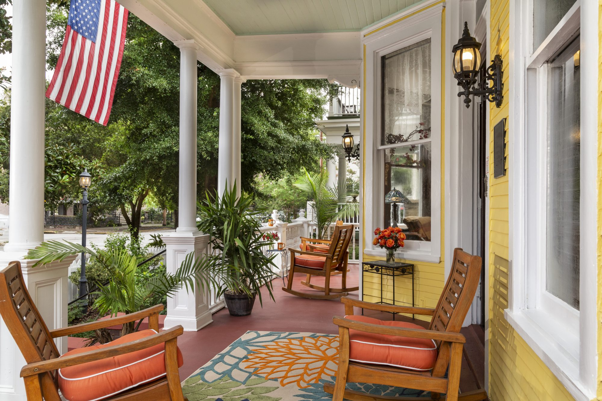 colorful yellow painted front porch