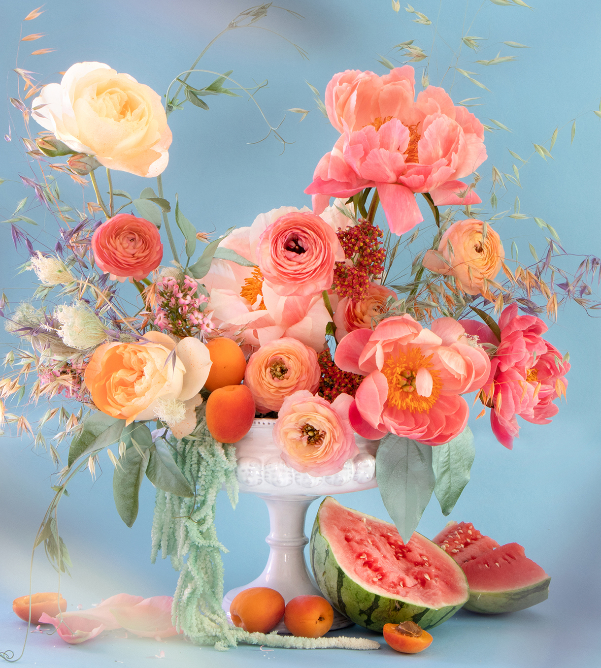 pink and orange flower arrangement with watermelons