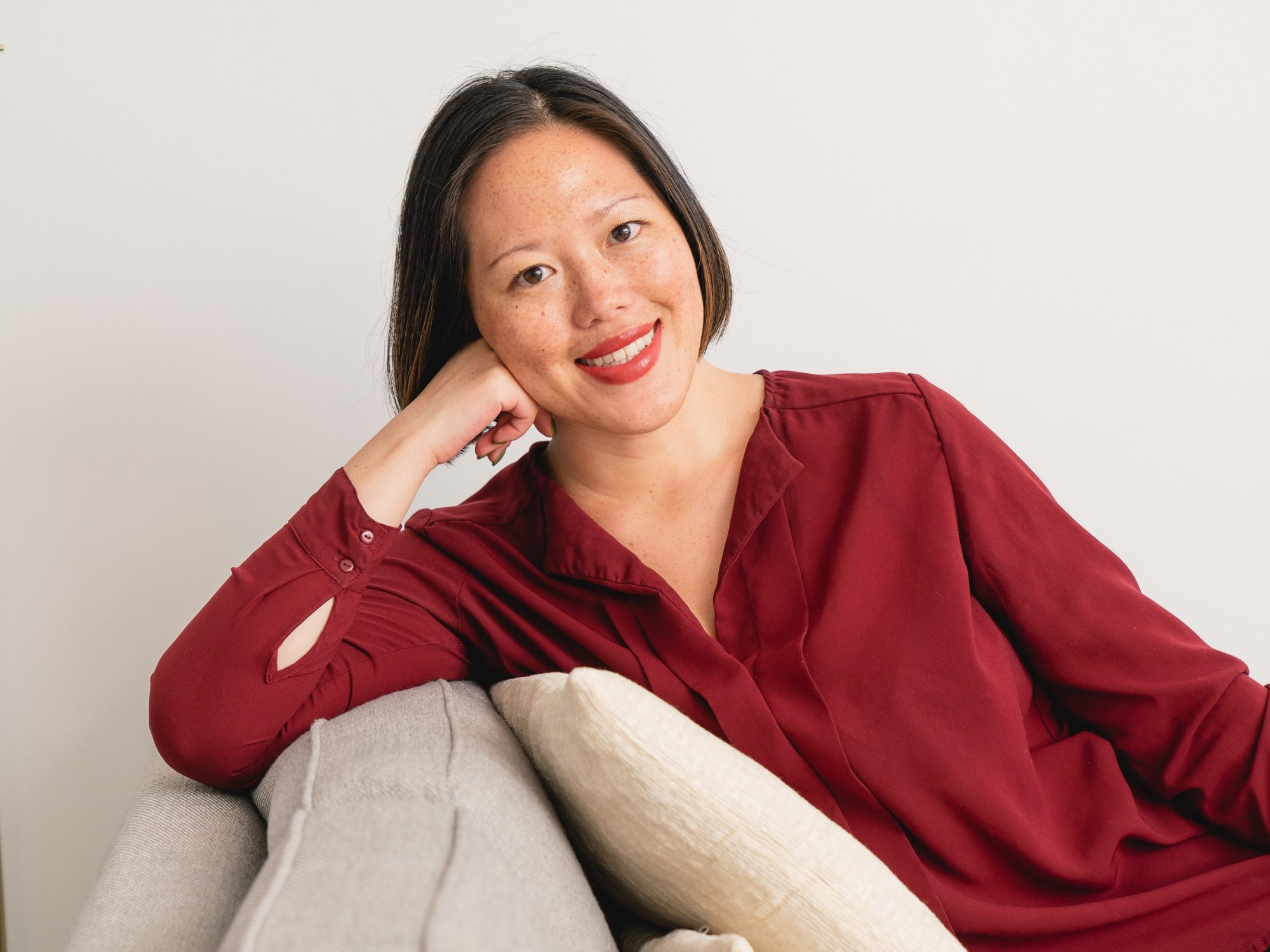 portrait of lin chen on couch