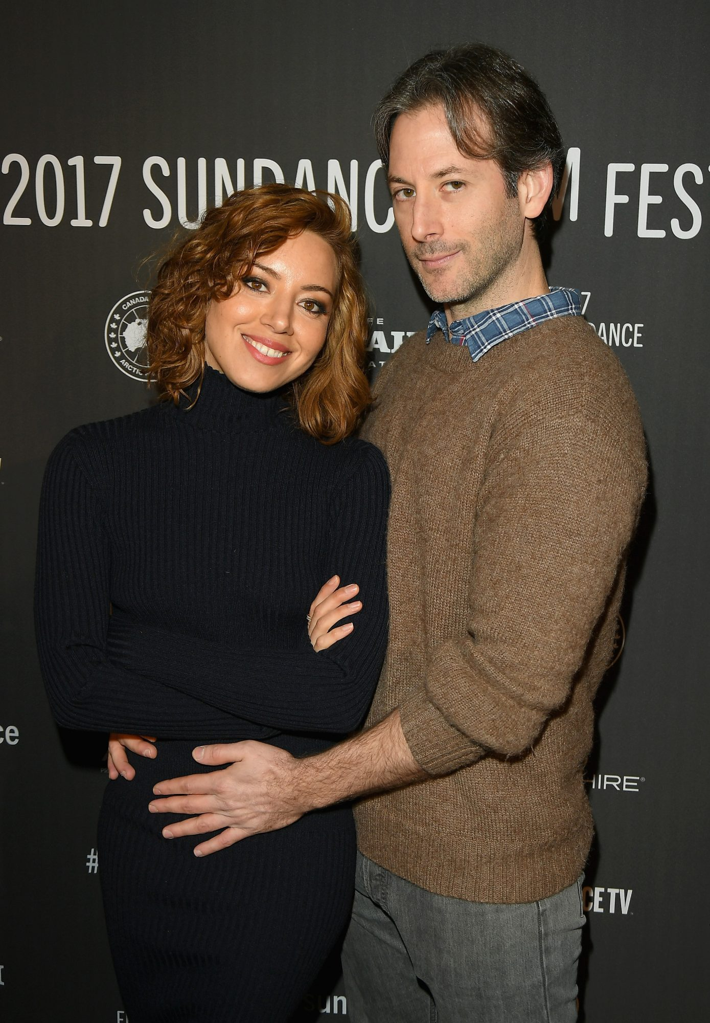 Aubrey plaza and Jeff Baena pose for photograph