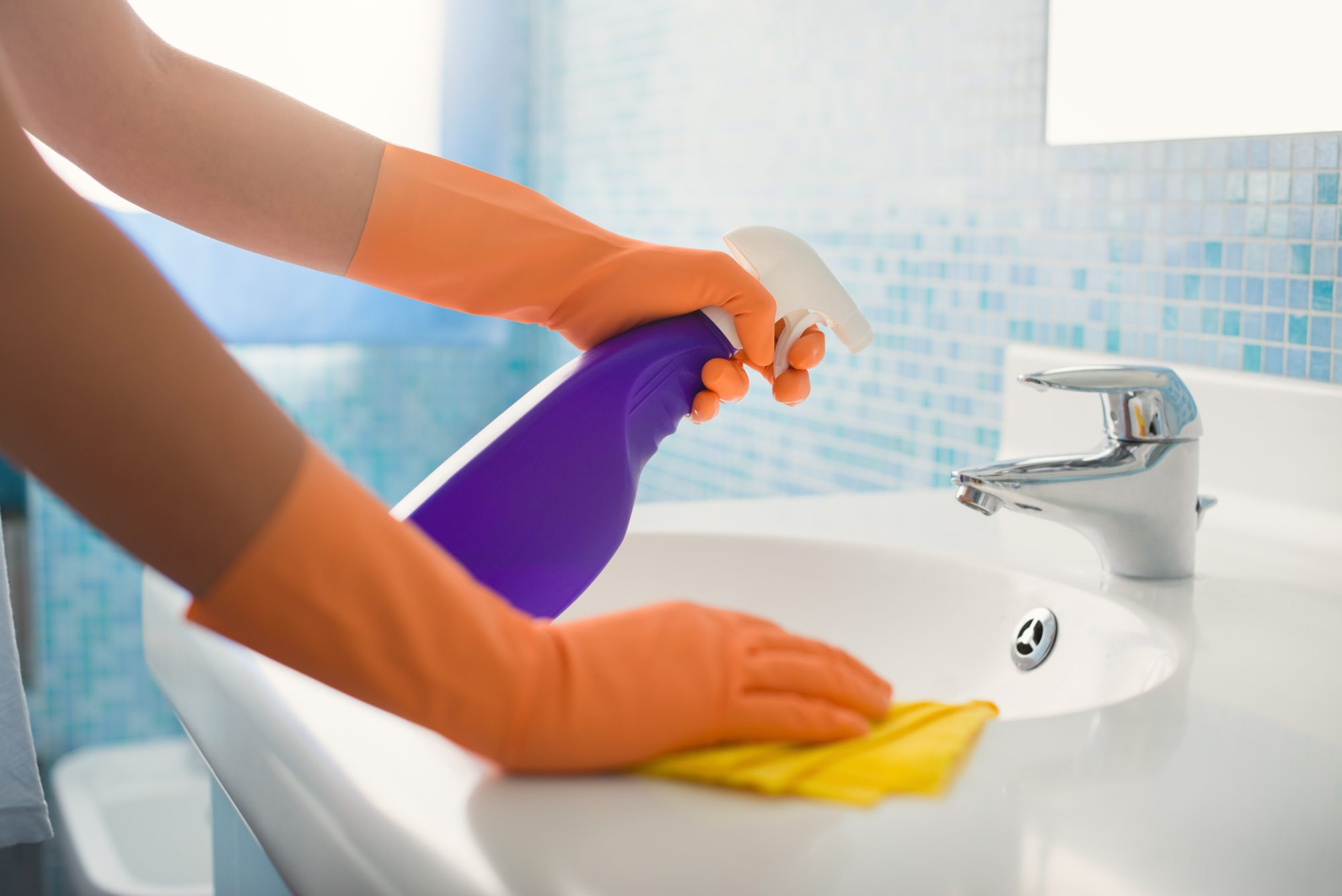 cleaning bathroom sink and counter