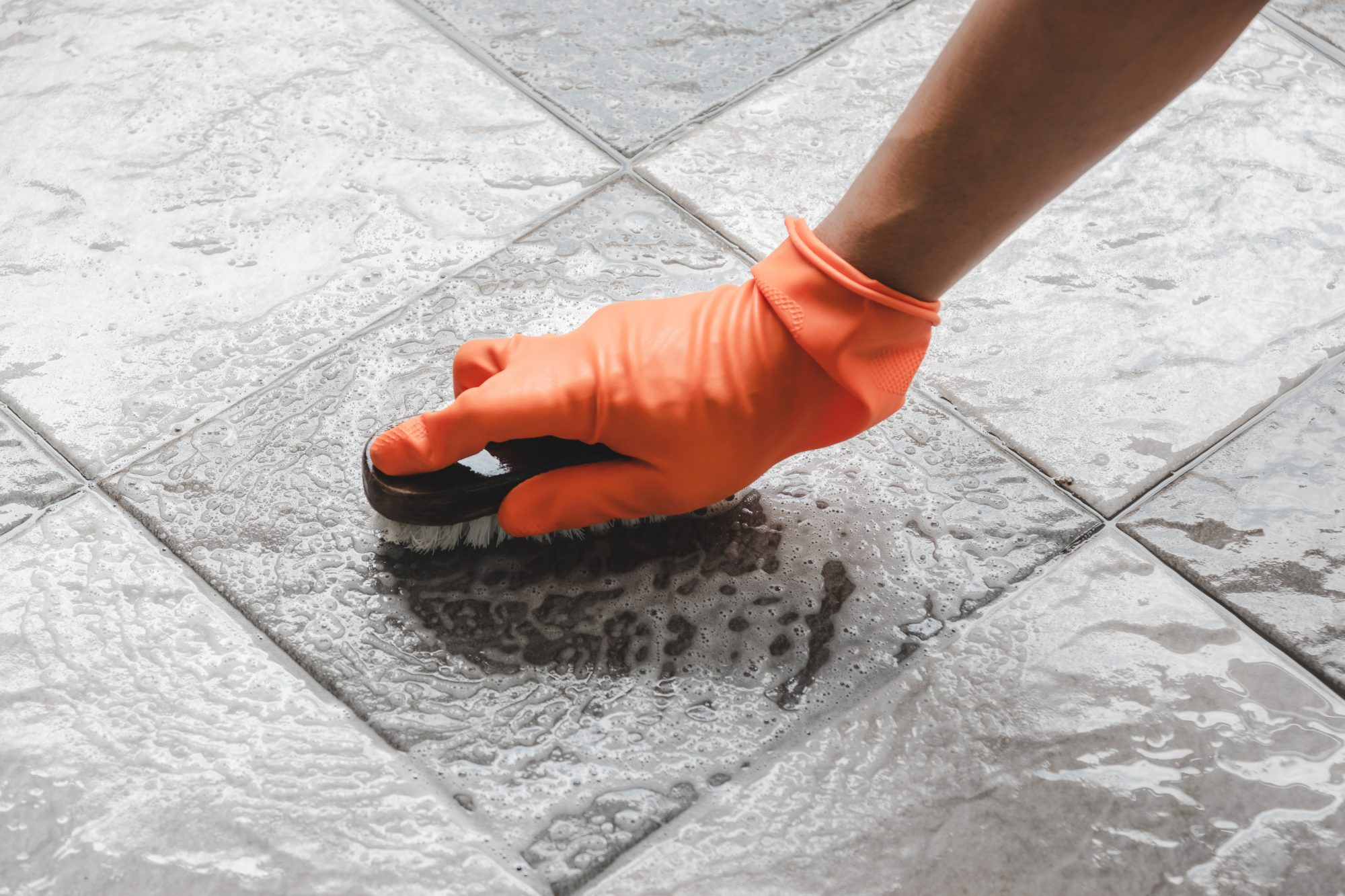 scrubbing bathroom tile floor
