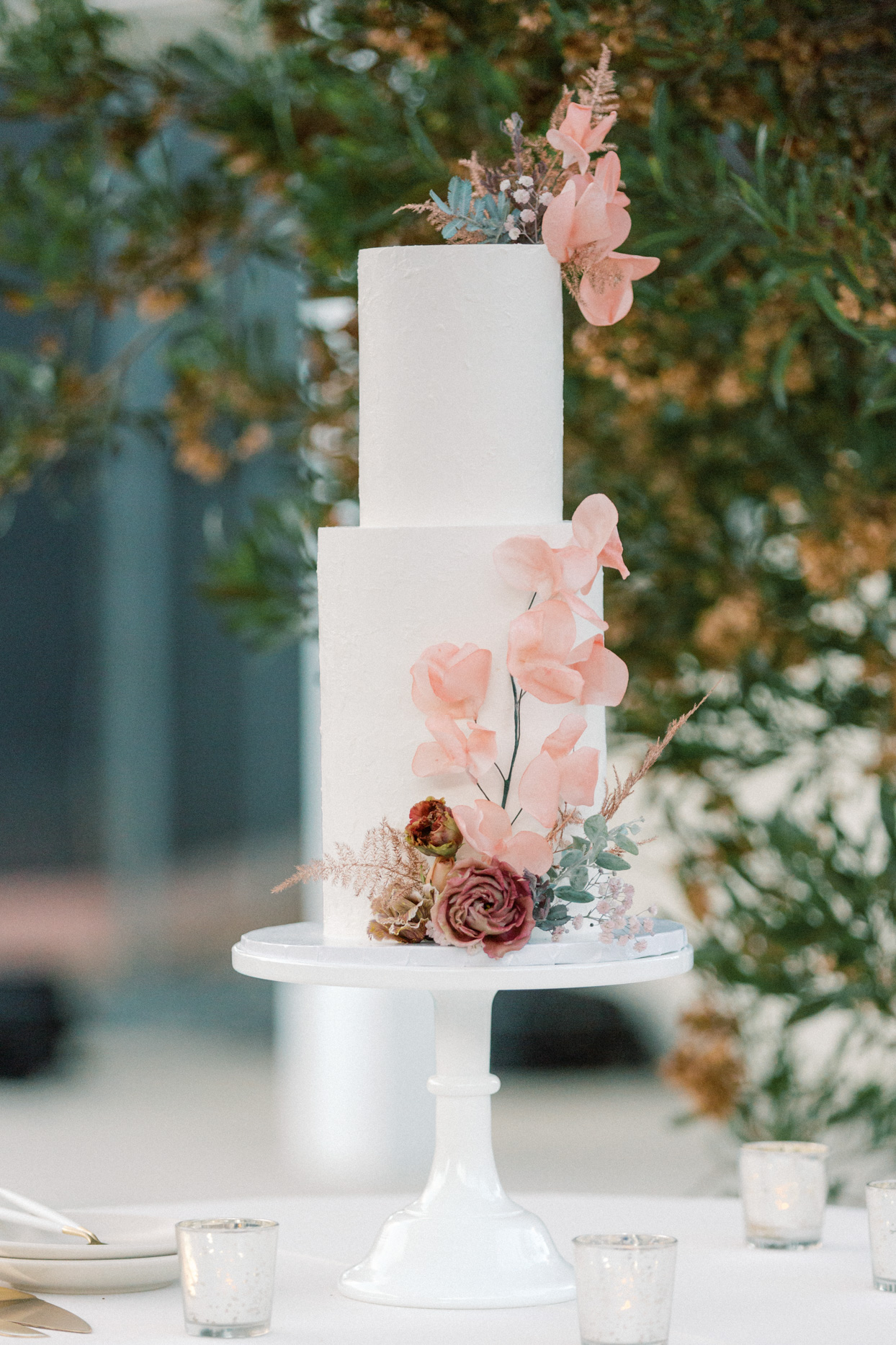 two-tier cake with pink hued flowers