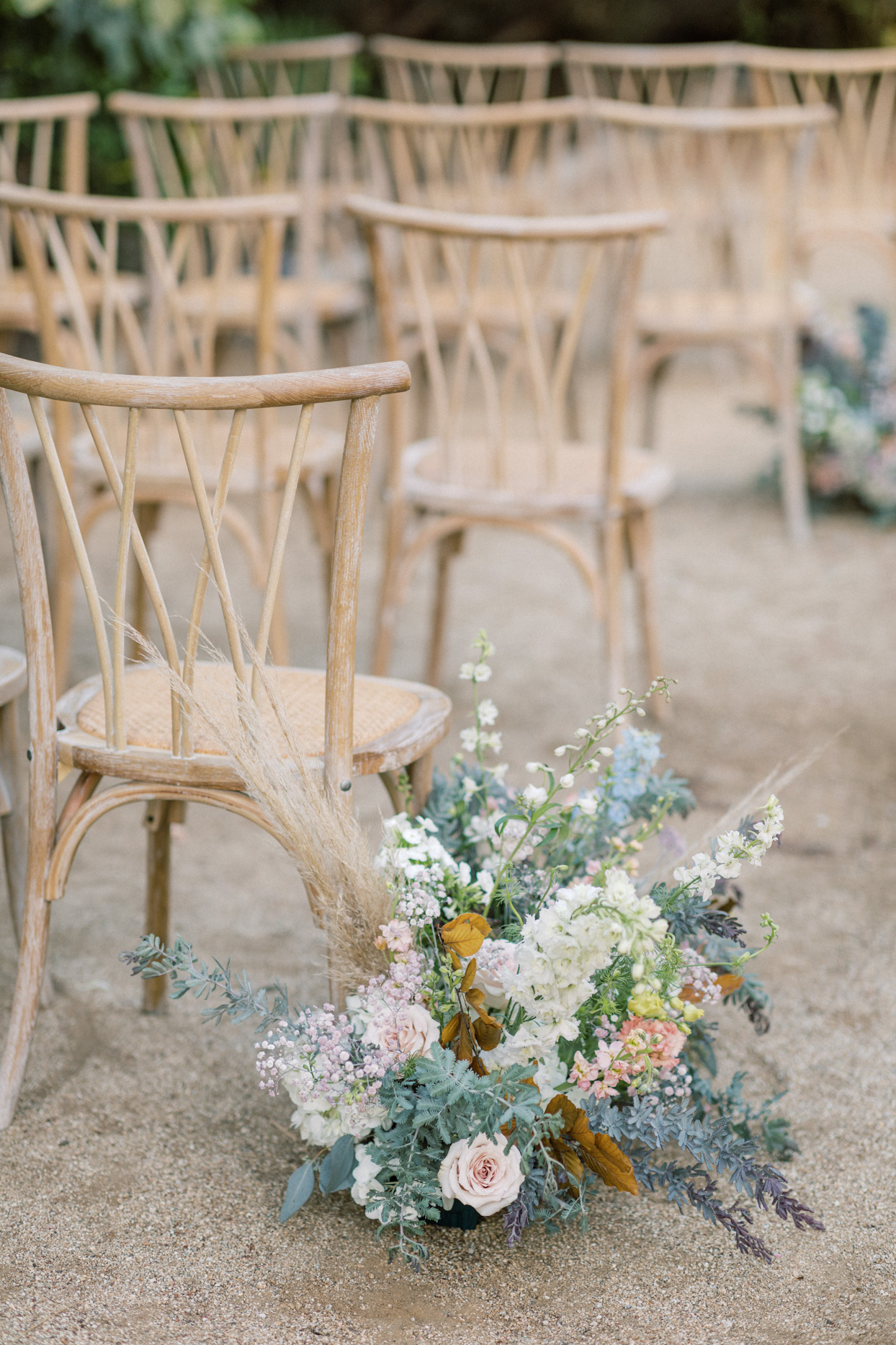 ceremony chairs with floral arrangements