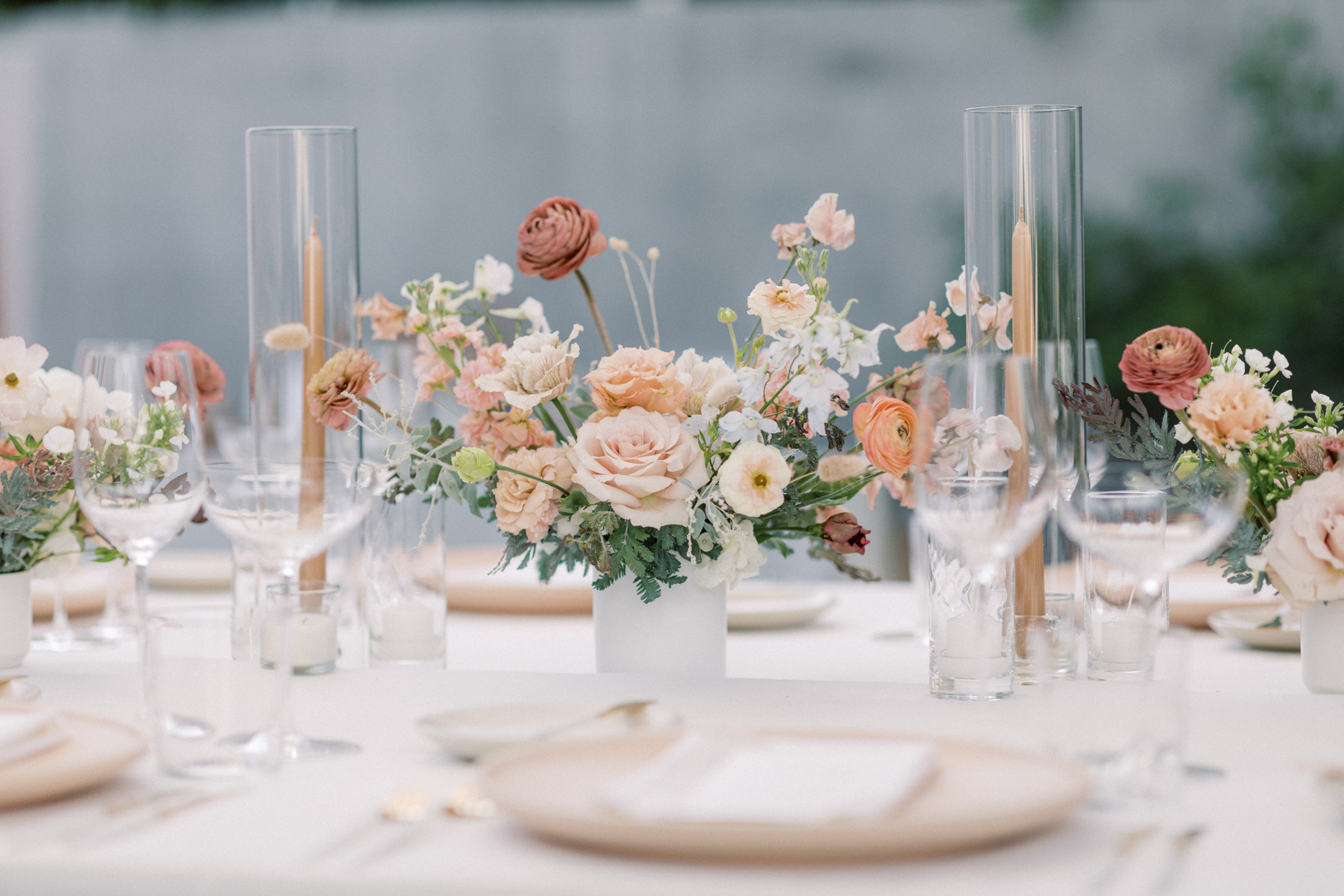 tall candles with blush floral centerpiece