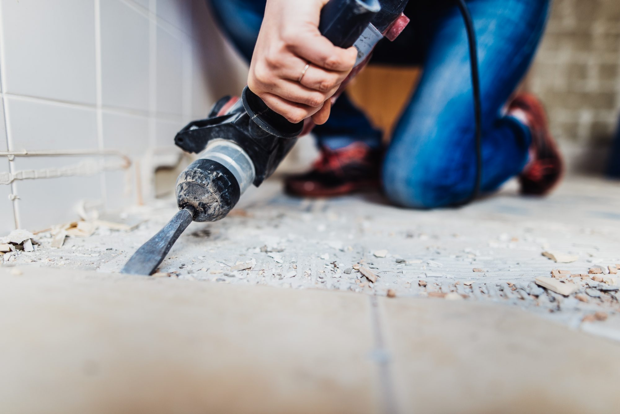 woman renovating bathroom tile