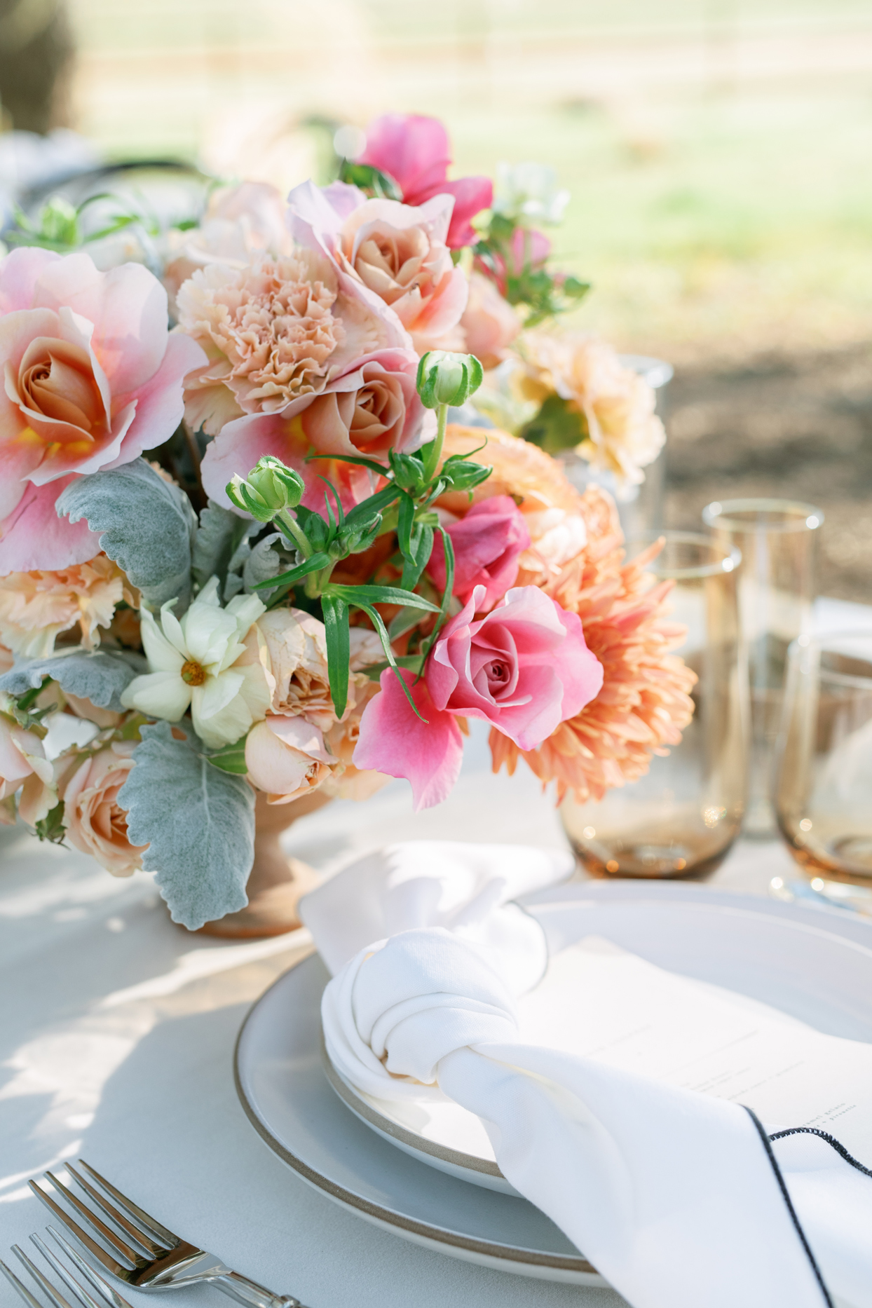 rehearsal dinner centerpieces comprised of drum roses
