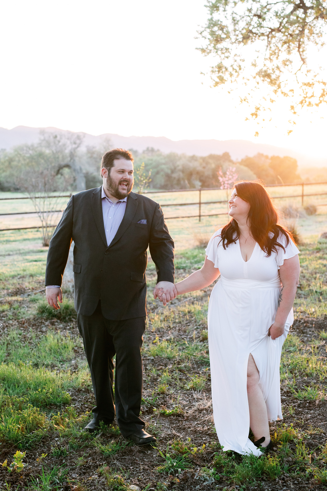 bride and groom holding hands california ranch backdrop