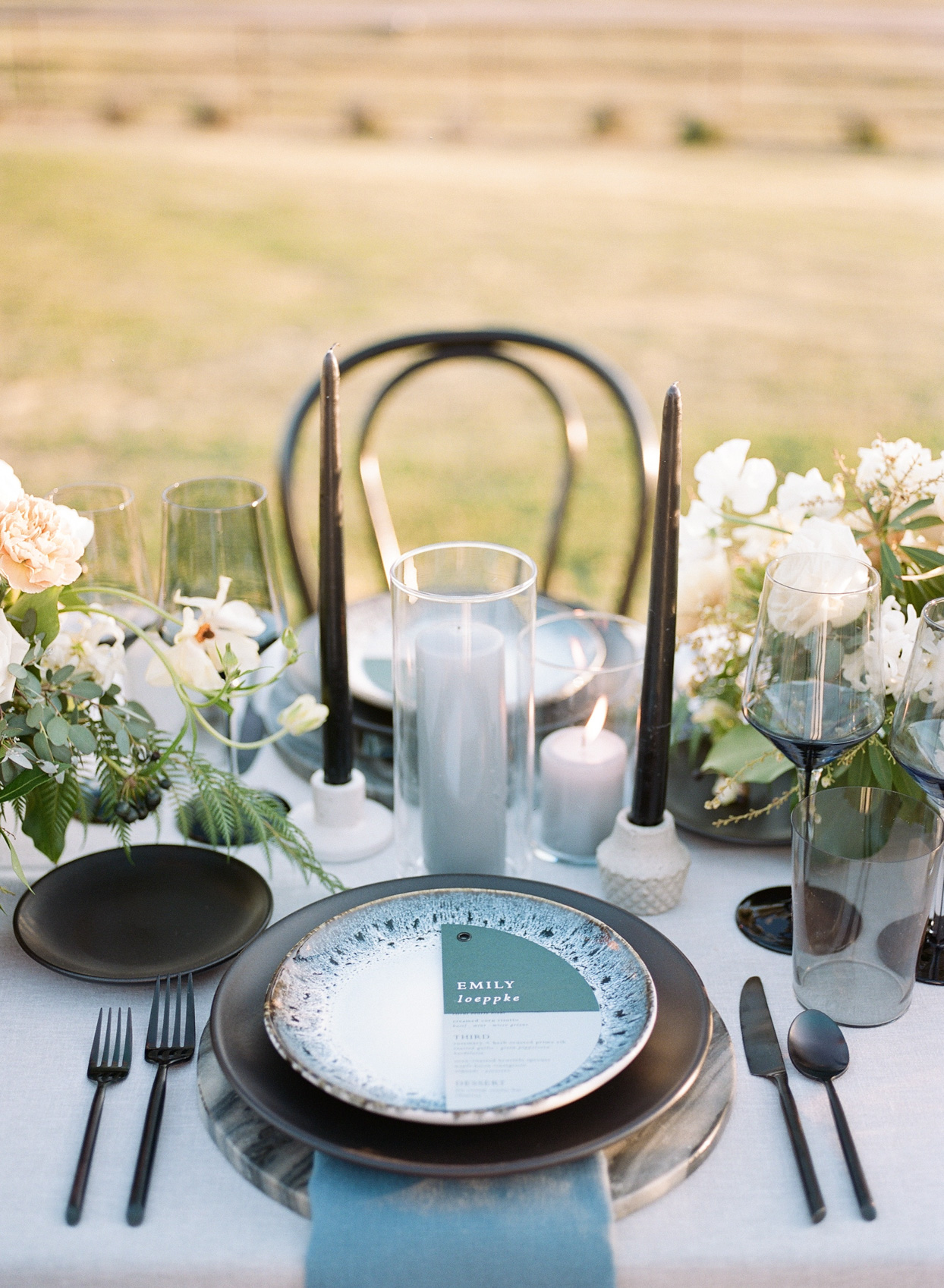 table setting with personalized menus and seating cards