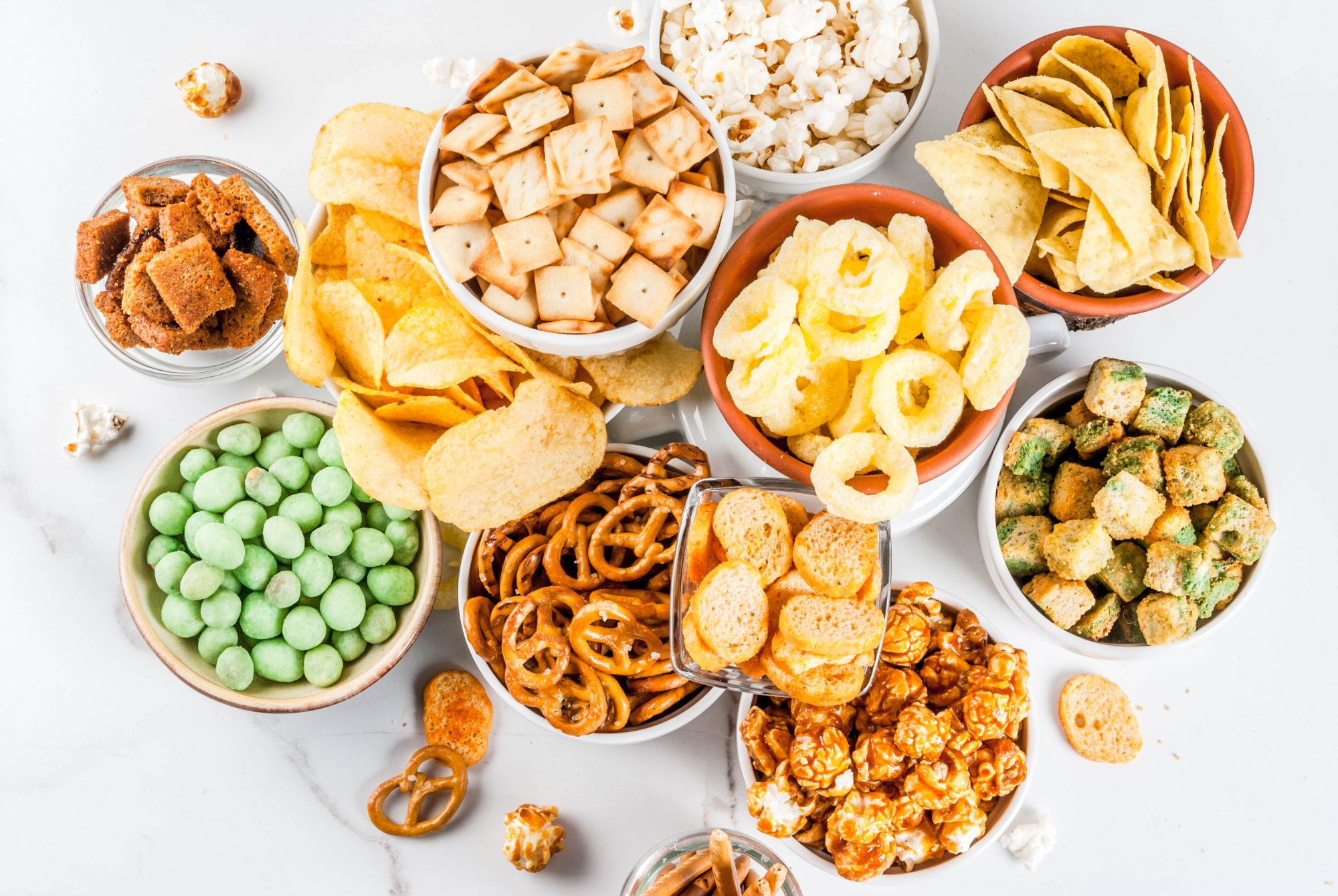 overhead image of savory and sweet snacks in bowls